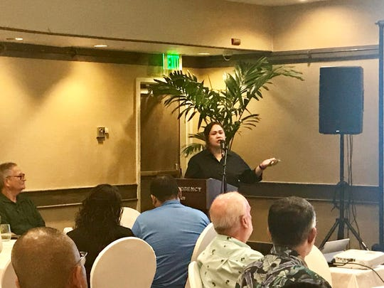 University of Guam Economics Professor Maria Ruane delivers an updated economic outlook statement on Wednesday at the Hyatt.
