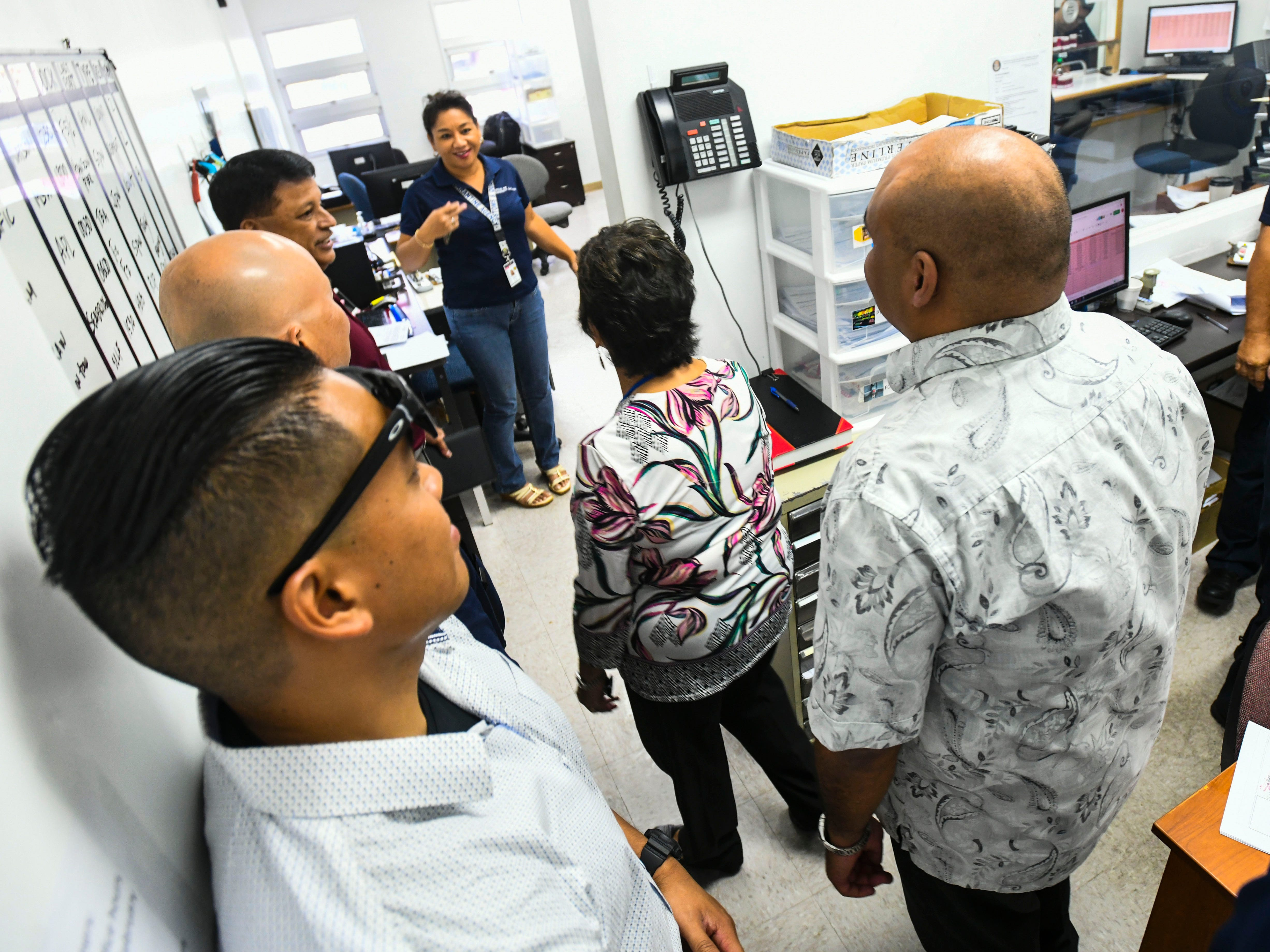 Gov. Lou Leon Guerrero, Lt. Gov. Josh Tenorio and others, tour the Customs office in the administration building at the Jose D. Leon Guerrero Commercial Port in Piti on Wednesday, March 13, 2019.