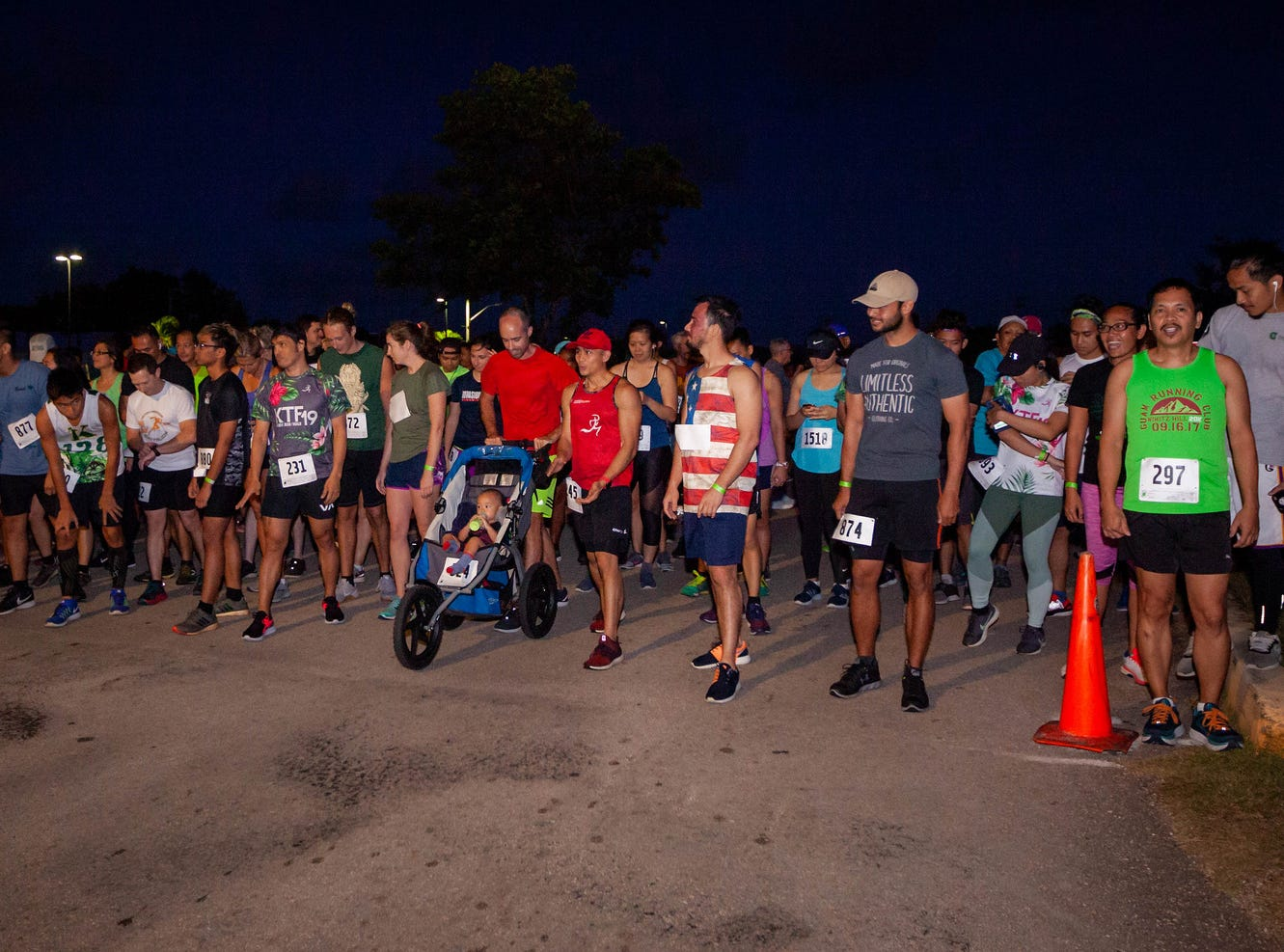 Runners line up at the starting line for the University of Guam Annual Charter Day 5K on March 12.