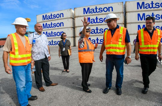 Gov. Lou Leon Guerrero asks Operations Manager John Santos a question about the gantry cranes during a tour she, Lt. Gov. Josh Tenorio and others, took while at the Jose D. Leon Guerrero Commercial Port in Piti on Wednesday, March 13, 2019.