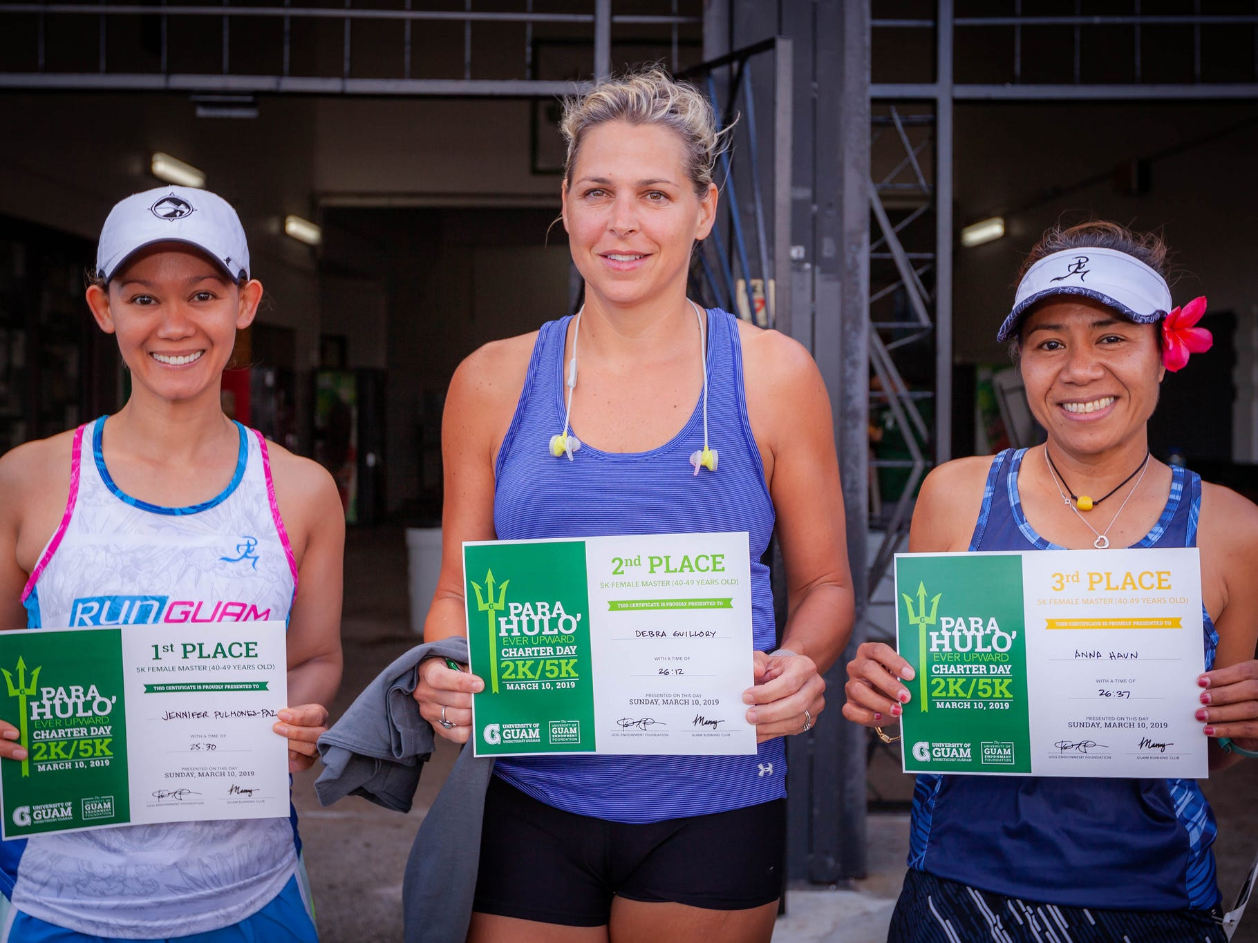 The top finishers in the University of Guam's Annual Charter Day 5K Women's Master Division, from left: Jennifer Pulmones-Paz; Debra Guillory; and Anna Haun. Pulmones-Paz was also the top female finisher overall.