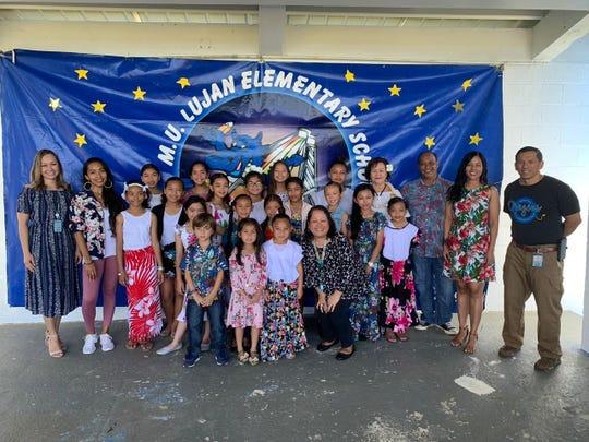 Pictured are the Hafa Adai Reps, mass reps. and storytelling competition reps. Front row, standing from left: Ina'tan Dunn; Tera Dela Cruz, Azi Babauta and Sinora LeVonne S. Mantanona. Middle row, standing from left: Hailee Hernandez; Alyssa Pendon; Brielle Reyes; Aurea Salas; LeShael Taimanglo; Anaiah Tareyama; Sarai Dela Cruz and Rio Serafico. Back row from left: NatashaJo A. Dela Cruz, Principal; Sinorita Eva A. Cruz, Ma'estra; Savannah Dela Rosa; Tiara Naputi; Persais Taitague; Hanaya Gamboa; Amiah Cepeda; Rylee Salas; Aveyani Babauta; Saina Rufina F. Mendiola; Sinot Albert C. Fejeran; Sinora Loretta P. Cruz and Elias Taisapic, Jr., assistant principal.
