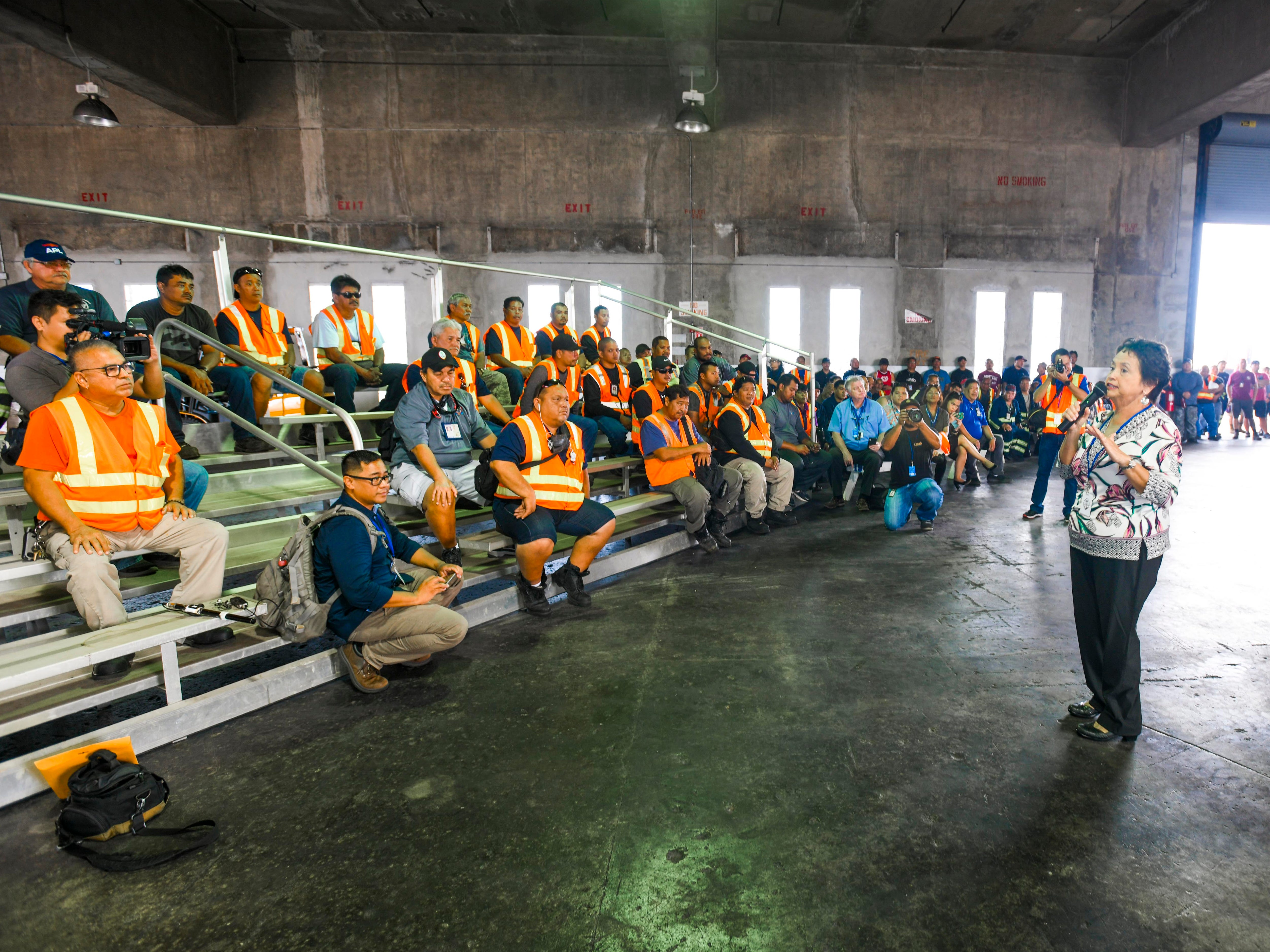 Gov. Lou Leon Guerrero speaks to port workers during a visit to the Jose D. Leon Guerrero Commercial Port in Piti, along with Lt. Gov. Josh Tenorio and others, on Wednesday, March 13, 2019.