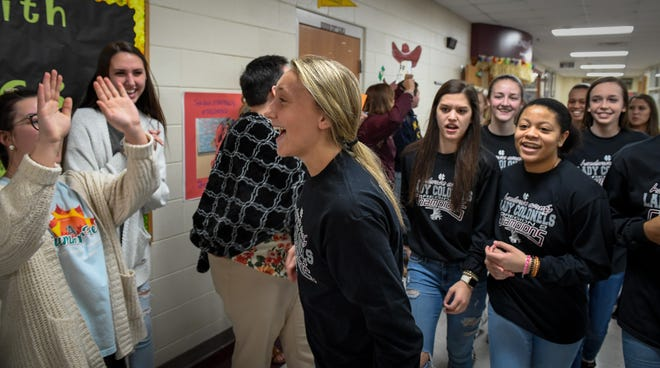 Lady Colonel Alyssa Dickson leads the way as the team cheered on by students at Henderson County High as they make their way to board a bus to Lexington for the Girls Sweet Sixteen Tournament in Wednesday, March 13, 2019.