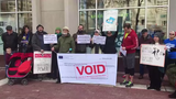 About a dozen people protested a bill that would make it easier for utilities to raise rates in front of IPL headquarters in Indianapolis on March 11.