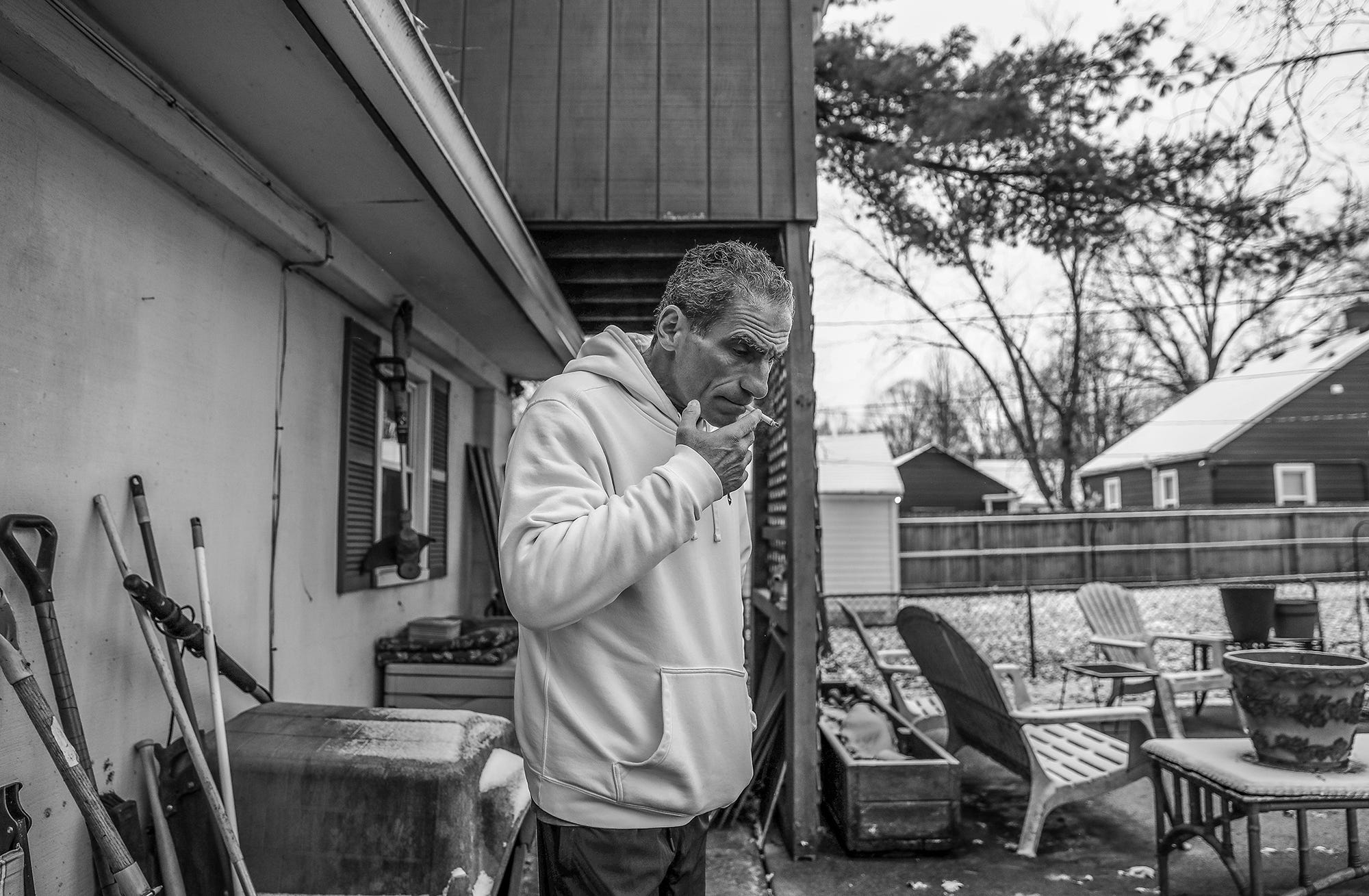 After his morning reading, Mat Pazzarelli has a cigarette at his home in Indianapolis on Wednesday, Dec. 5, 2018.