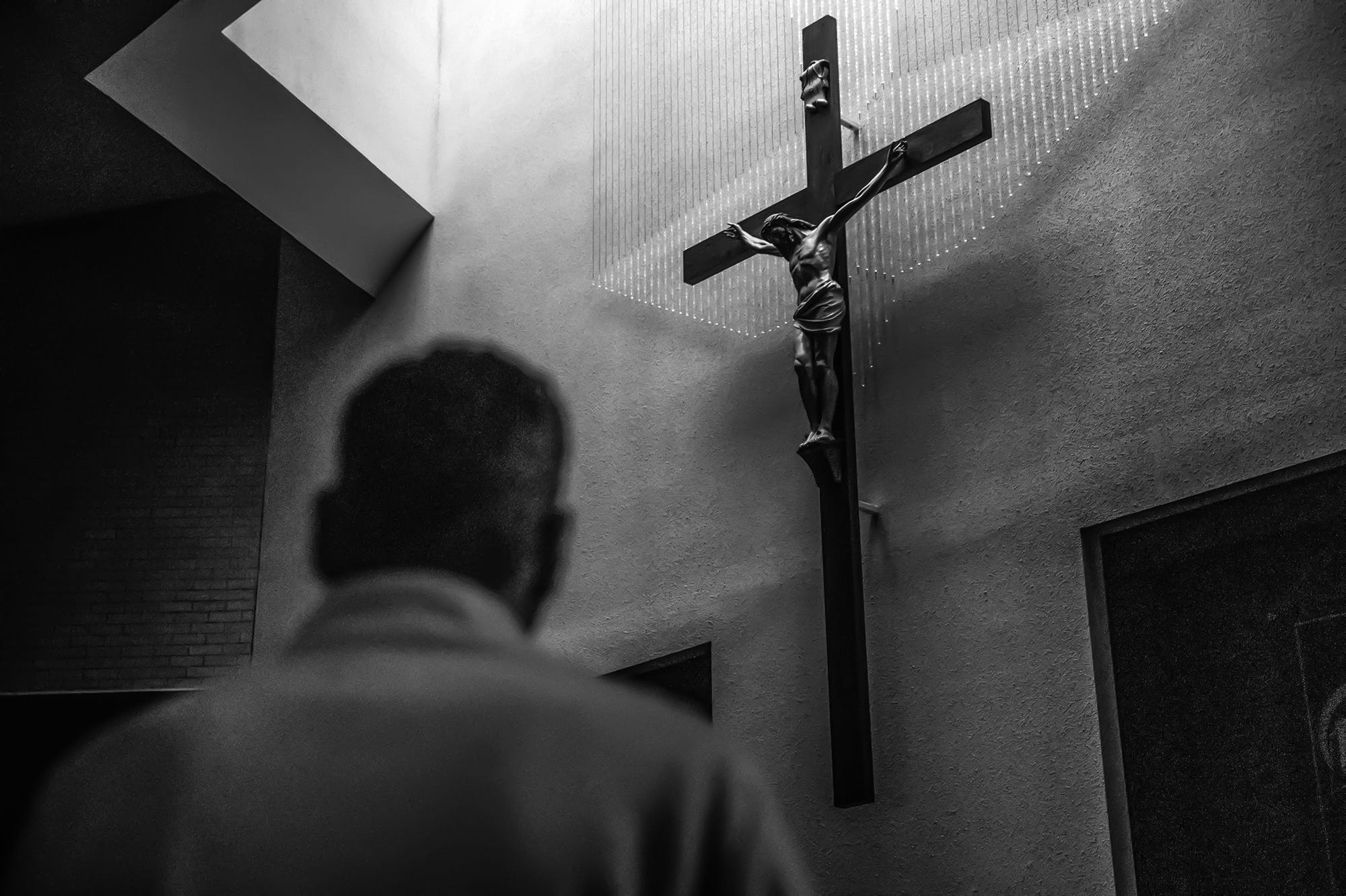 After a quick dinner at Joella's Broad Ripple, Mat Pazzarelli goes through a personal prayer ritual at St. Matthew The Apostle on Wednesday, Feb. 27, 2019. The prayers take Pazzarelli 15 minutes to sing. After, he attends a church service.
