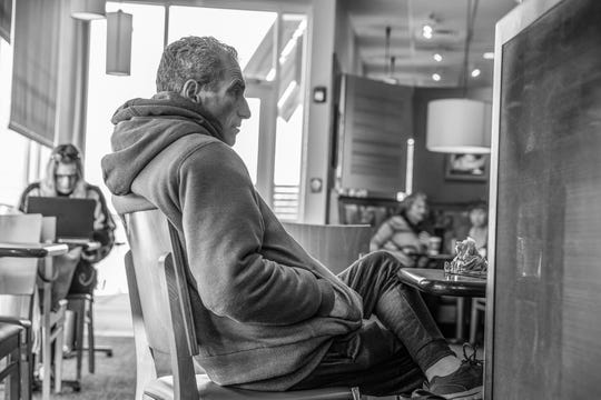 Mat Pazzarelli councils Andrew (not pictured), a recovering addict, at a Panera Bread in Indianapolis on Dec. 7, 2018. Pazzarelli, formerly John Franzese Jr., goes to Panera daily.