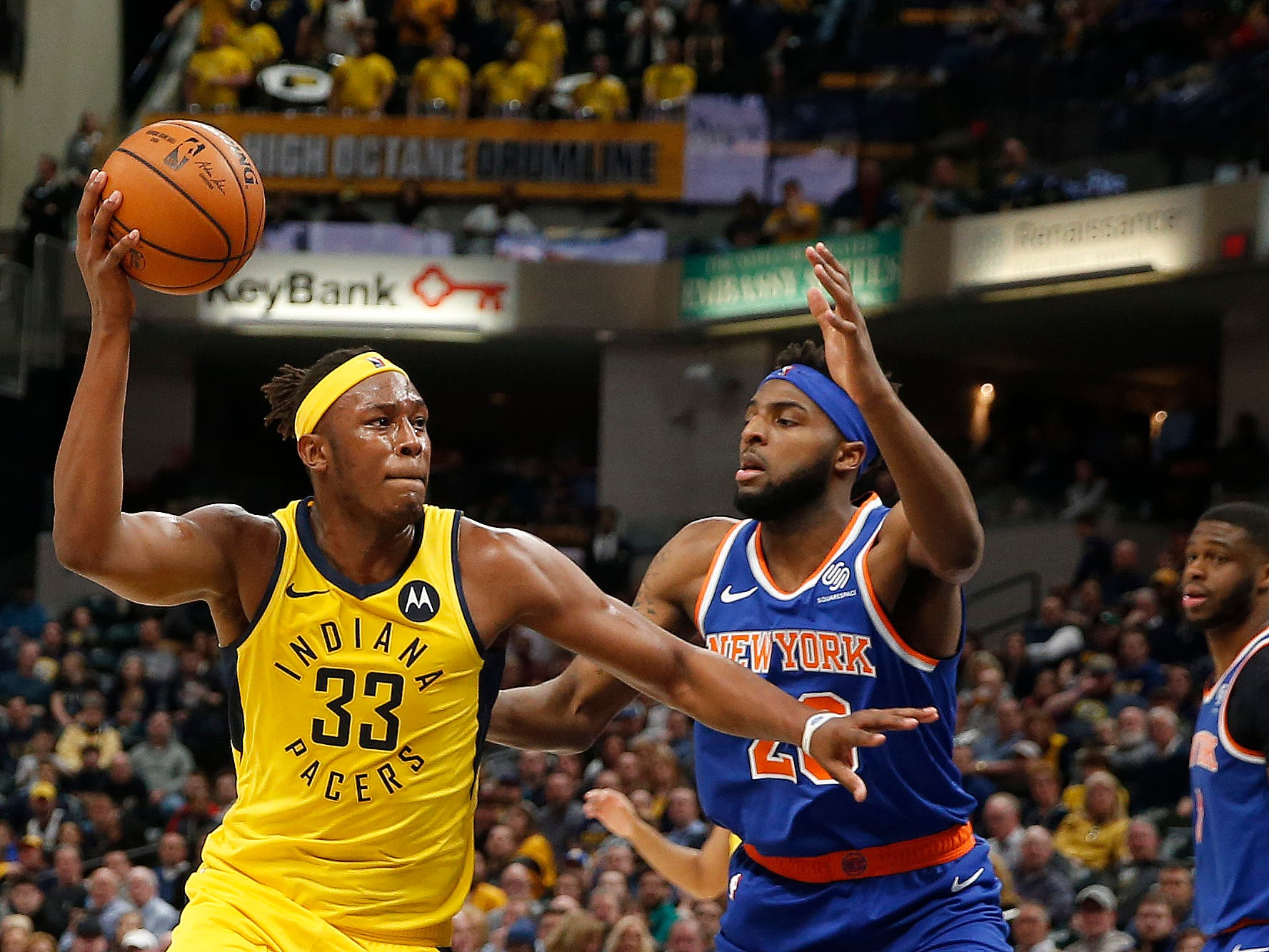 Mar 12, 2019; Indianapolis, IN, USA; Indiana Pacers center Myles Turner (33) is guarded by New York Knicks center Mitchell Robinson (26) during the third quarter at Bankers Life Fieldhouse.