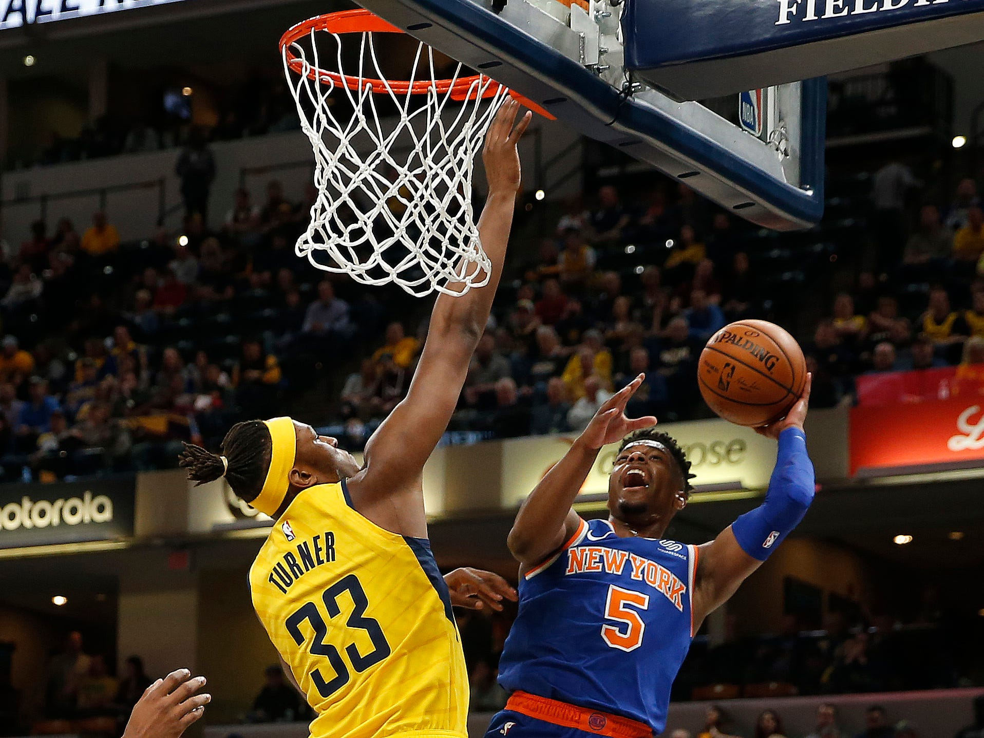 Mar 12, 2019; Indianapolis, IN, USA; New York Knicks guard Dennis Smith Jr. (5) takes a shot against Indiana Pacers center Myles Turner (33) during the first quarter at Bankers Life Fieldhouse.