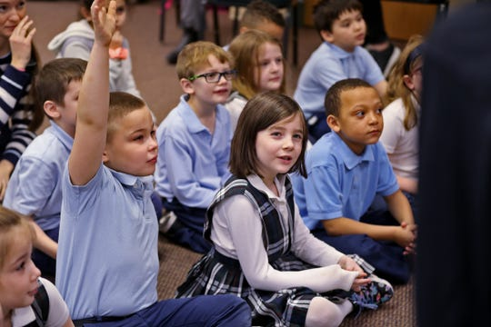 Our Lady of Lourdes School students ask questions about disabilities, after a puppet show put on by the Joseph Maley Friends Puppet Troupe, as part of a Disabilities Awareness program, Monday, March 11, 2019.  The Joseph Maley Foundation uses differently-abled puppets to teach children about disabilities.