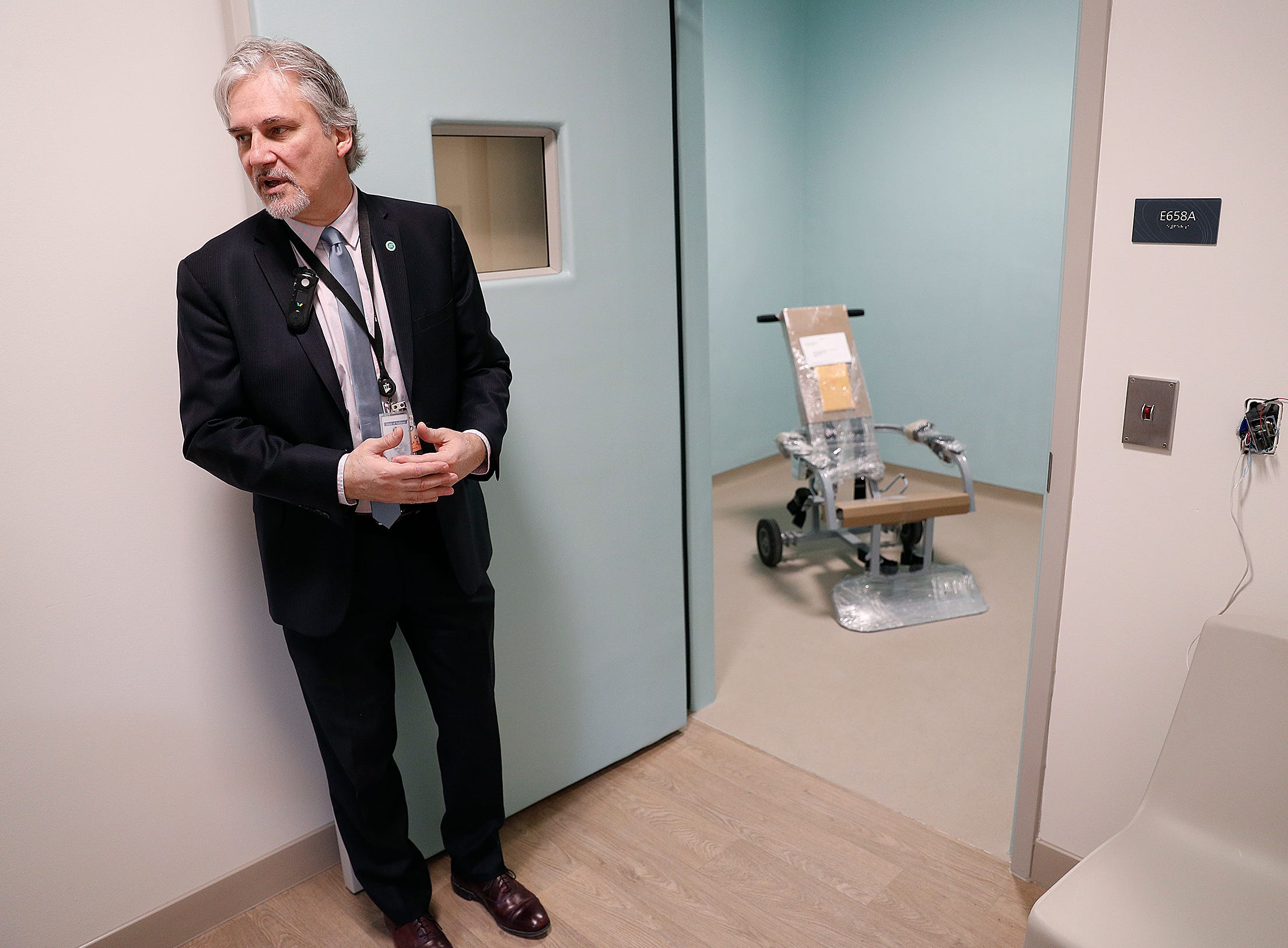 Jerry Sheward, M.D., shows one of the seclusion rooms in the new NeuroDiagnostic Institute, at 5435 E 16th St., will replace LaRue Carter as the center for mental health care on Wednesday, March 13, 2019.