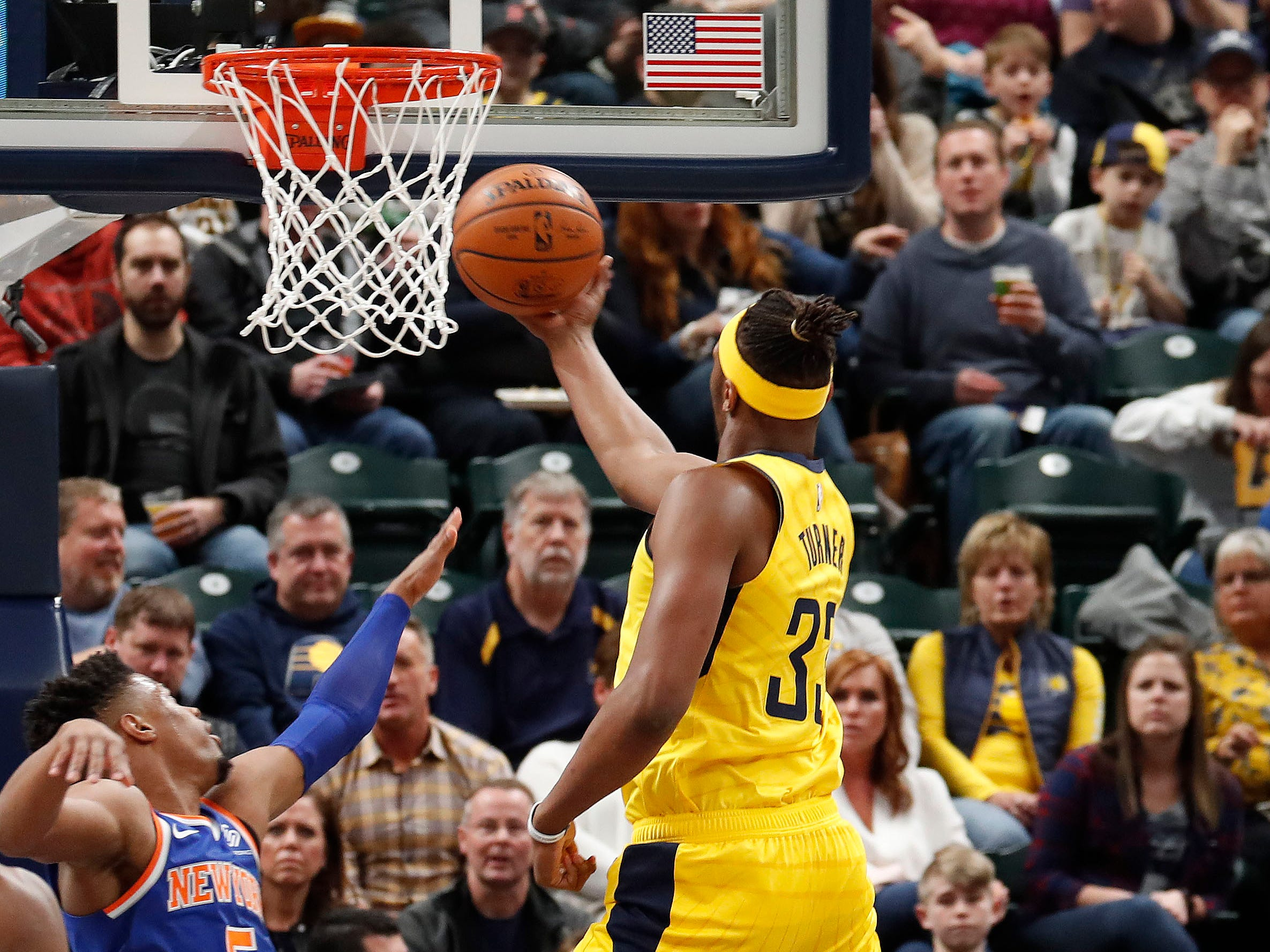 Mar 12, 2019; Indianapolis, IN, USA; Indiana Pacers center Myles Turner (33) takes a shot against New York Knicks guard Dennis Smith Jr. (5) during the first quarter at Bankers Life Fieldhouse.