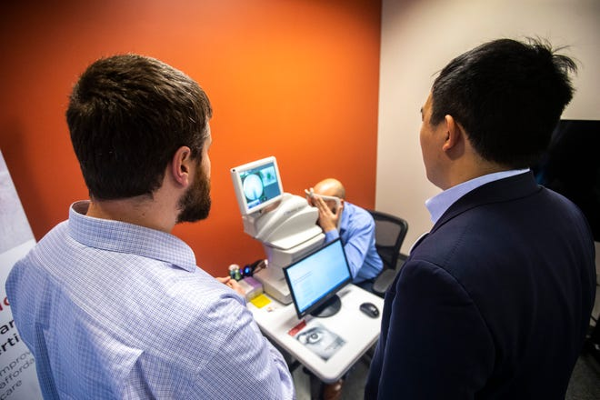 Leadership at IDx Technologies Inc. says their company is poised to grow in 2020. In March of 2019, 2020 presidential candidate Andrew Yang, right, was shown a demonstration of the company's main product, the IDx-DR. This device is an AI diagnostic system that autonomously analyzes images of the retina for signs of diabetic retinopathy.