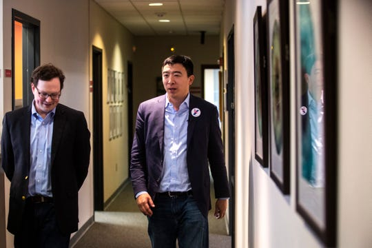2020 presidential candidate Andrew Yang, right, visits with Benjamin Clark, IDx president and COO, on Wednesday, March 13, 2019, at IDx Technologies Inc. in Coralville, Iowa.