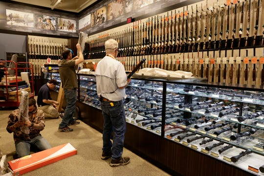 Employees stock guns at a Dick's Sporting Goods store in Lafayette, Louisiana, in 2016.