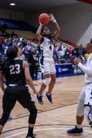 Christina Ellis goes up for a shot during Jackson State's game against Alabama State in the first round of the SWAC Tournament
