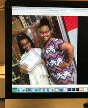 Ericka Hughes (right) is shown with her daughter in this photo of a Facebook post.