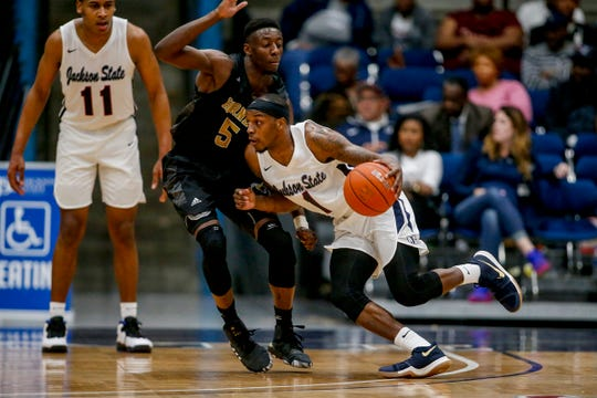 Jackson State's Chris Howell tries to drive Alabama State's Tobi Ewuosho during the opening round of the SWAC Tournament in Jackson.