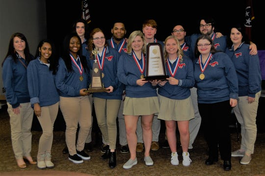 After winning state championships for the sixteenth consecutive year, Madison Academic High School students will compete against teams across the country in Minneapolis at the end of April for the United States Academic Decathlon. Pictured, back row from left: Leven Ward, Thomas Brown, Will Gibson, Robert Yin, Brian Lane, Coach Linda Sikes Lane; front row from left: Coach Paula Hatcher-Maxon, Quri Twitty, Chamiya Spates, Mary Hardy, Kaitlynn Wilson, Olivia Bezold, Abbey Moore