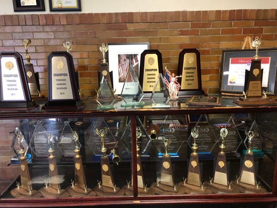 The trophy case for the Academic Decathlon team sits in the main  entrance of Madison Academic High School.