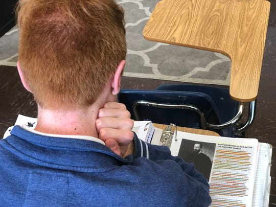 William Gibson, a senior Academic Decathlon member at Madison, studies the 1960s theme. There is a theme each year in which the subjects of music, economics, art, history, science and math revolves around.