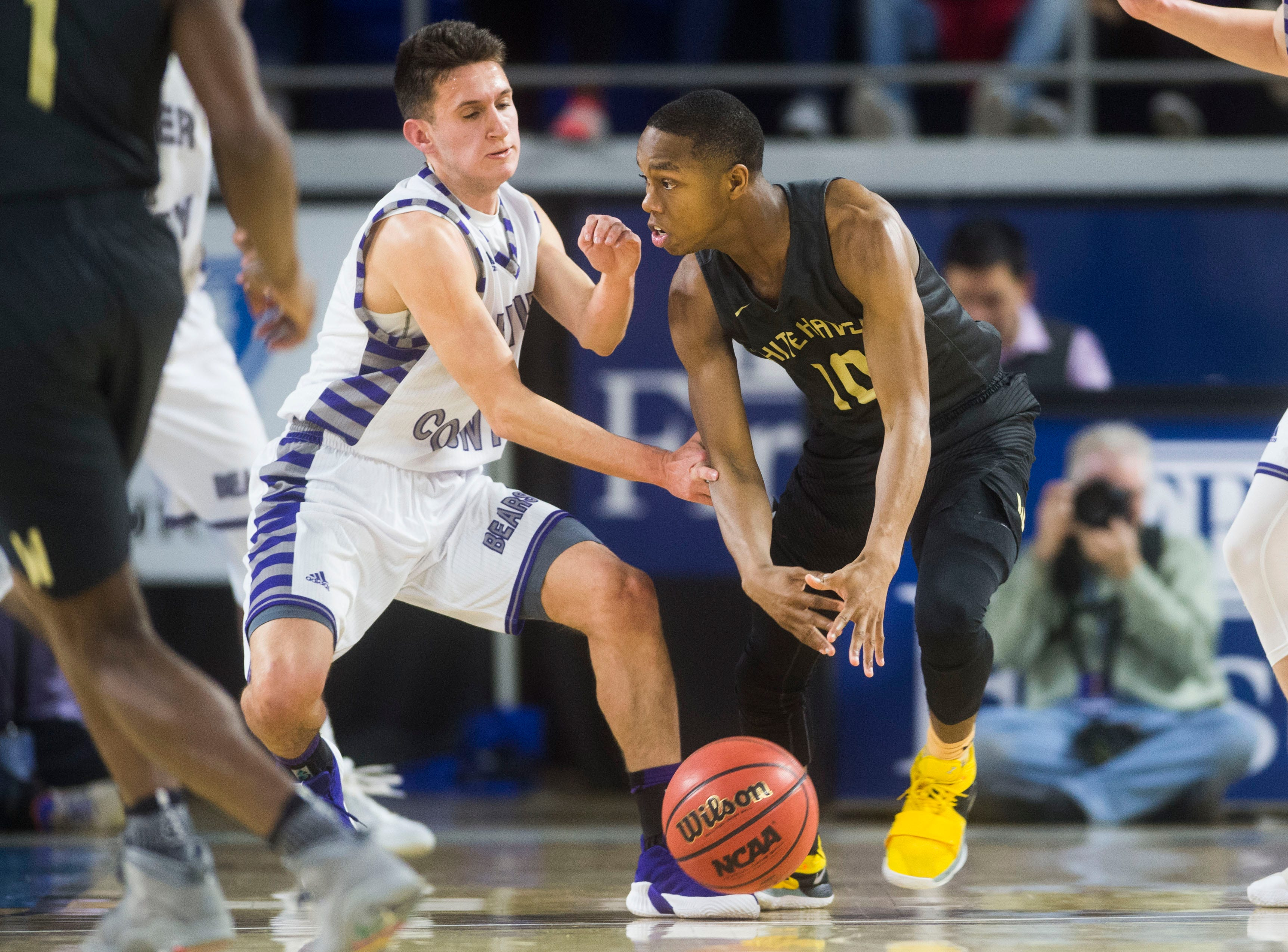 Whitehaven's Antwarn Smith (10) dribbles the ball down the court during a TSSAA AAA state quarterfinal game between Sevier County and Whitehaven at the Murphy Center in Murfreesboro, Wednesday, March 13, 2019.