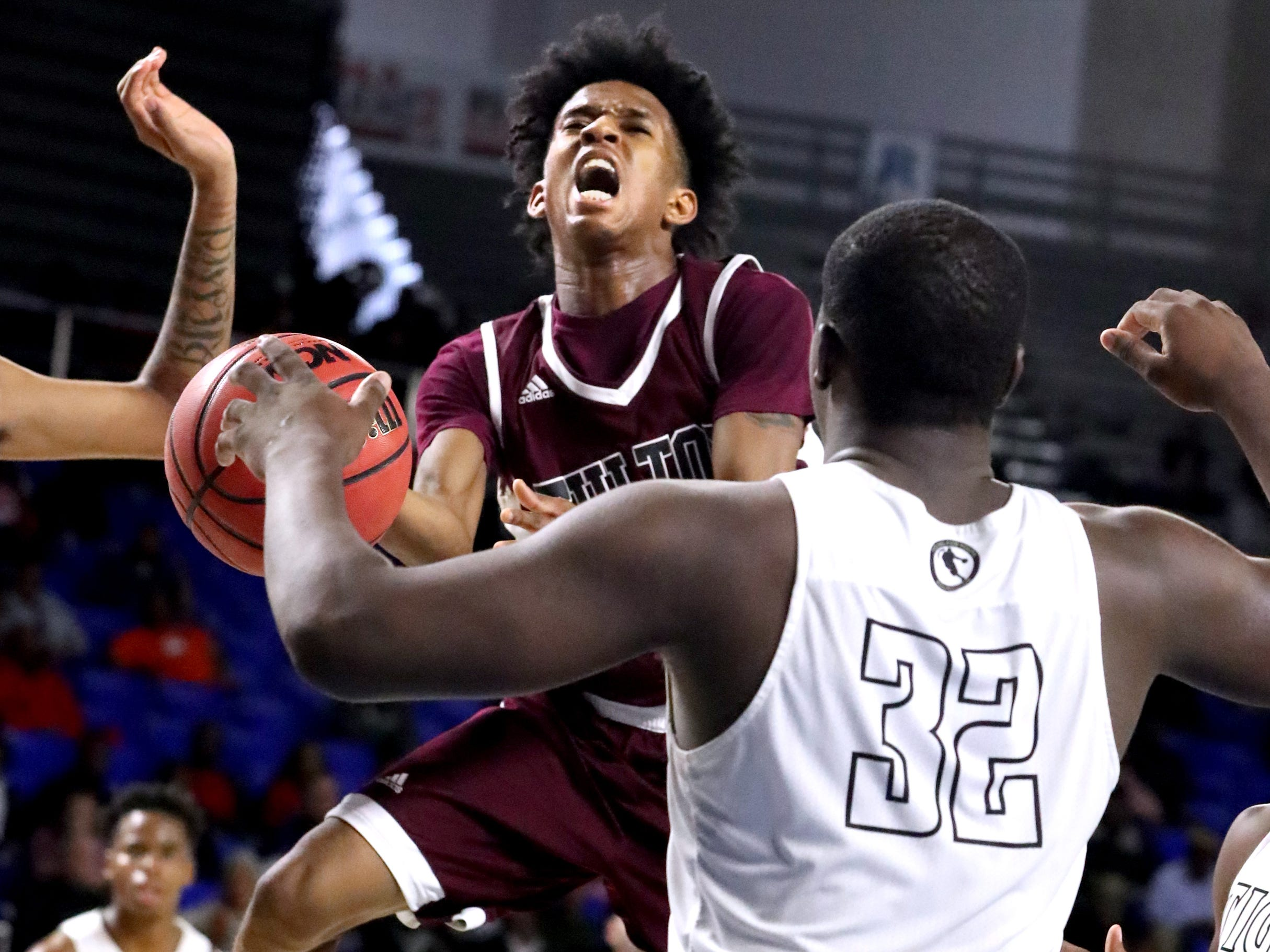 Fulton's Edward Lacy (4) goes up for a shot asMitchell's Cameron Powers (32) guards him during the quarterfinal round of the TSSAA Class AA Boys State Tournament, on Wednesday, March 13, 2019, at Murphy Center in Murfreesboro, Tenn.