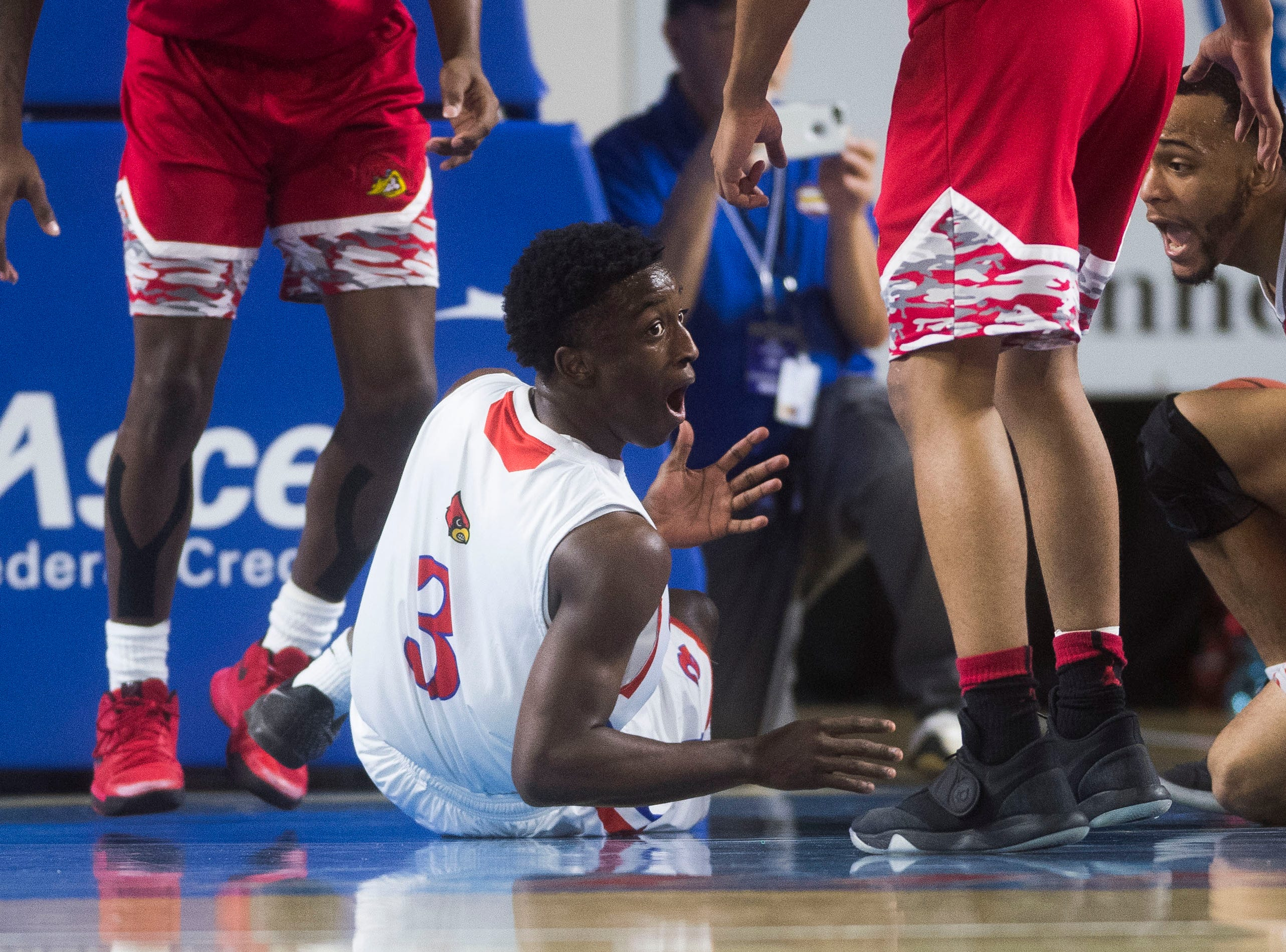 Wooddale's Alvin Miles (3) reacts to a call during a TSSAA AA state quarterfinal game between Austin-East and Wooddale at the Murphy Center in Murfreesboro, Wednesday, March 13, 2019.