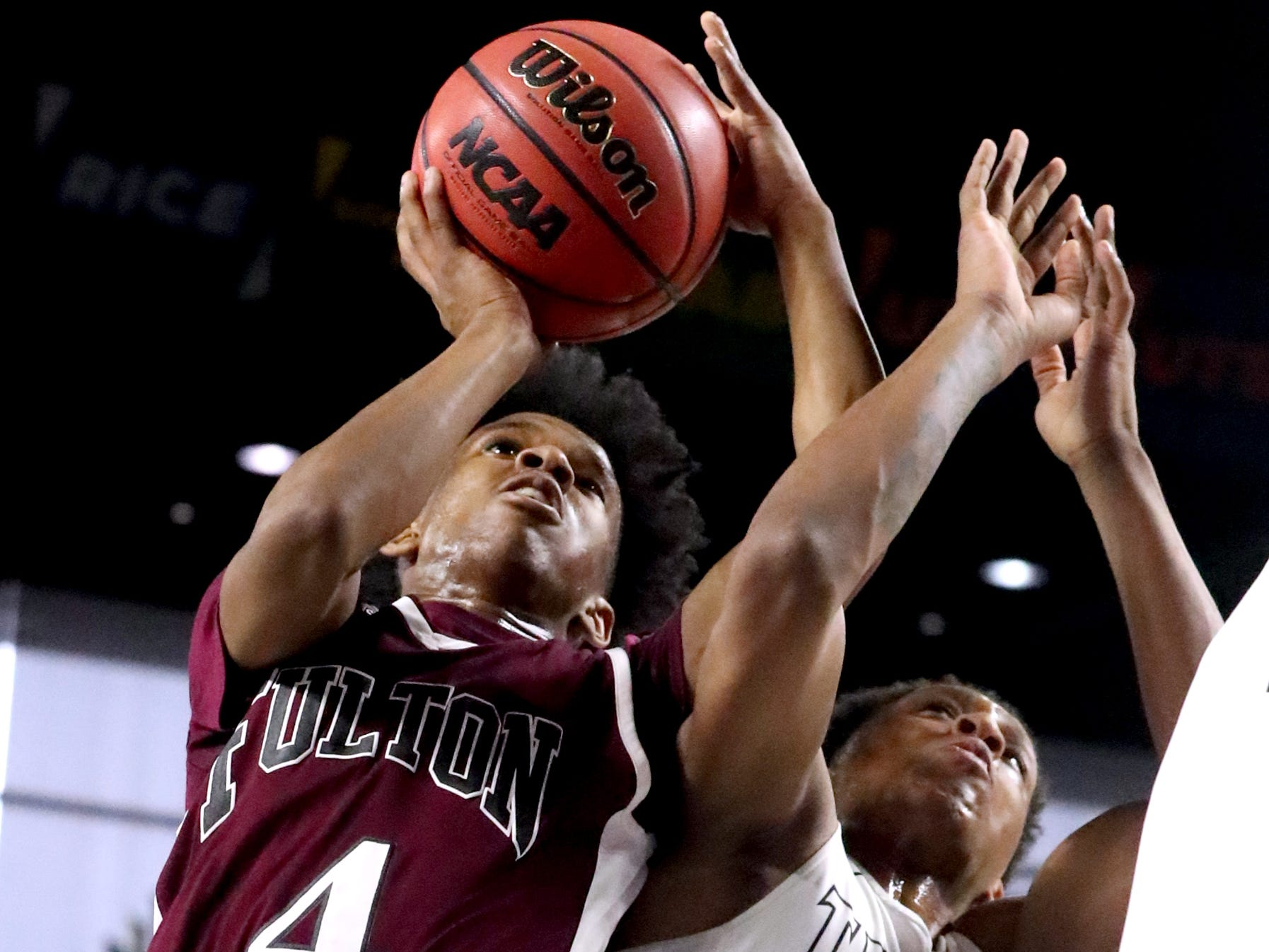 Fulton's Edward Lacy (4) shoots the ball as Mitchell's Jamarious Horton (2) guards him during the quarterfinal round of the TSSAA Class AA Boys State Tournament, on Wednesday, March 13, 2019, at Murphy Center in Murfreesboro, Tenn.