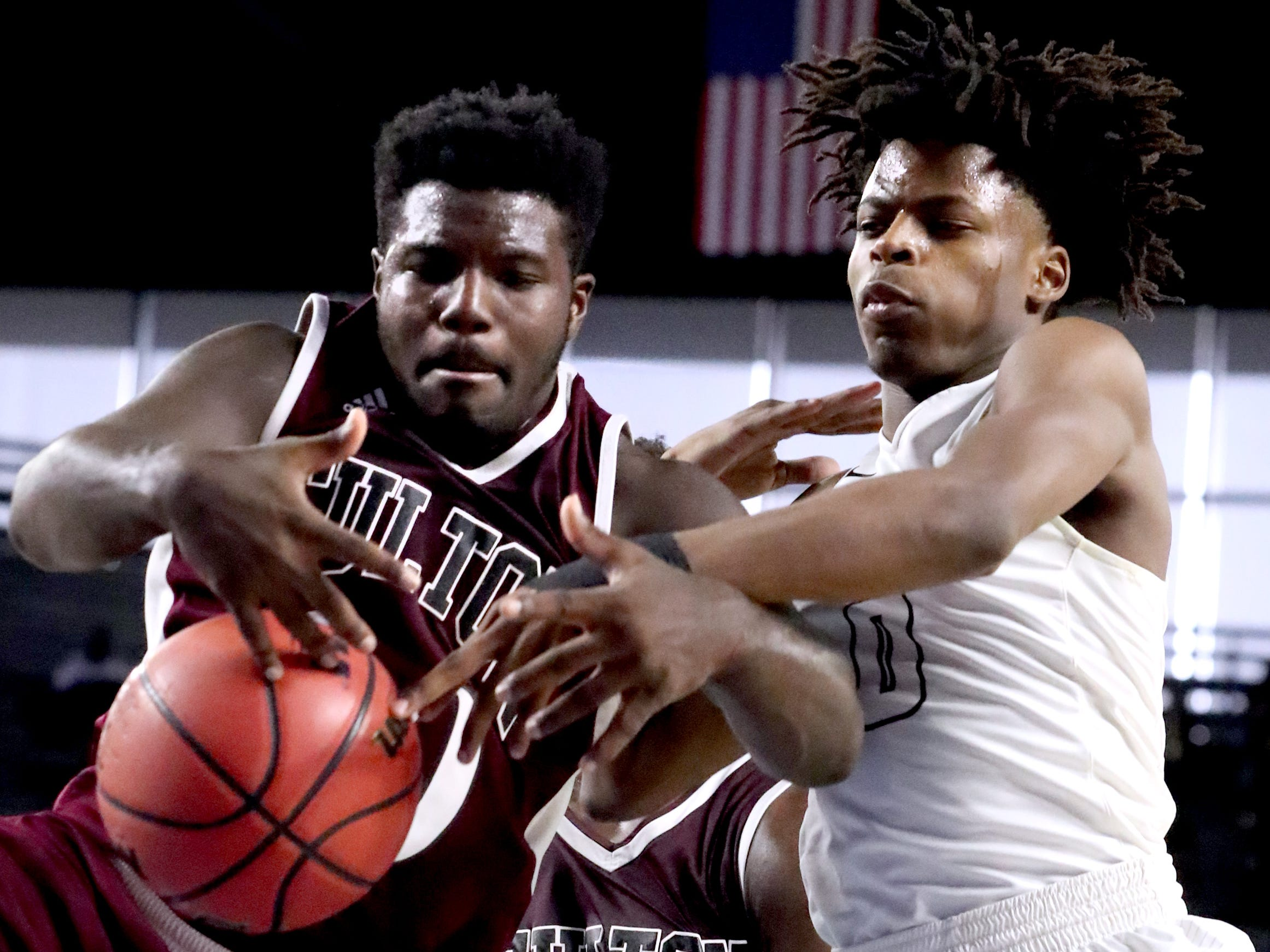 Fulton's Jashaun Fenderson (30) and Mitchell's Michael Rice (0) both go after a rebound during the quarterfinal round of the TSSAA Class AA Boys State Tournament, on Wednesday, March 13, 2019, at Murphy Center in Murfreesboro, Tenn.