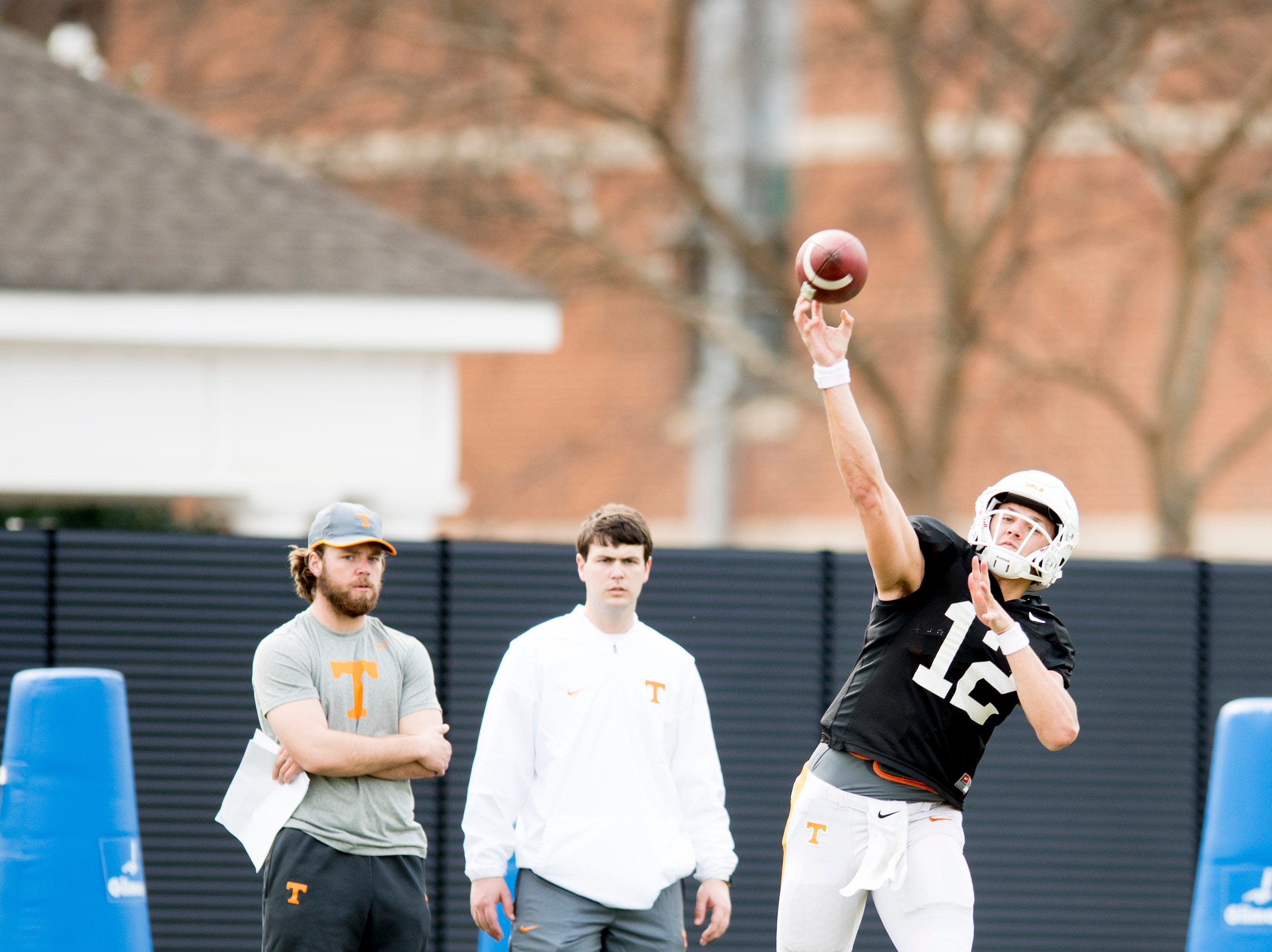 Tennessee quarterback JT Shrout (12) throws a pass during Tennessee spring football practice at  Haslam Field in Knoxville, Tennessee on Wednesday, March 13, 2019.