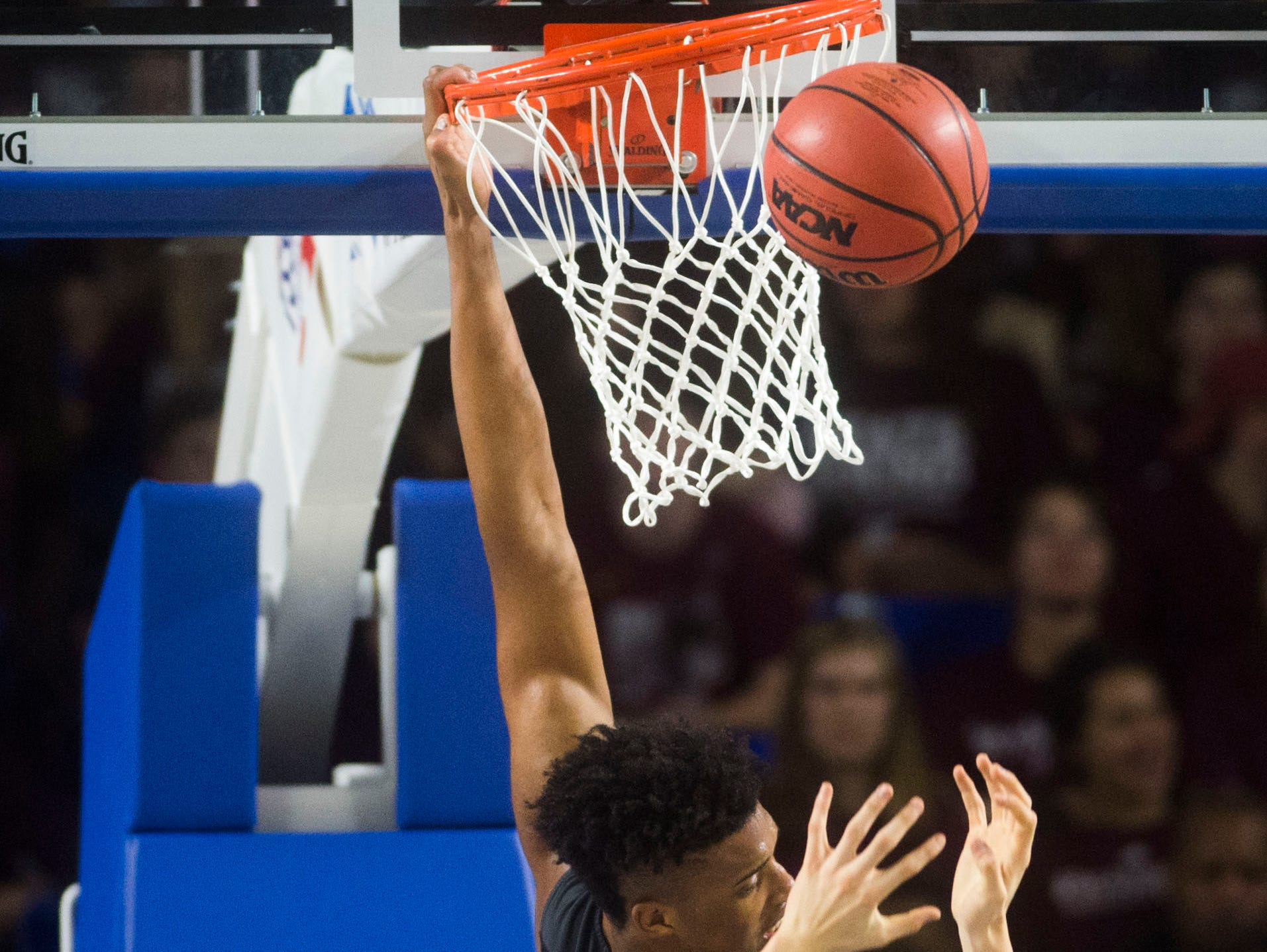 Whitehaven's Jordan Wilmore (30) dunks the ball during a TSSAA AAA state quarterfinal game between Sevier County and Whitehaven at the Murphy Center in Murfreesboro, Wednesday, March 13, 2019.