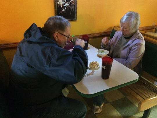 Two diners enjoy a lunch.