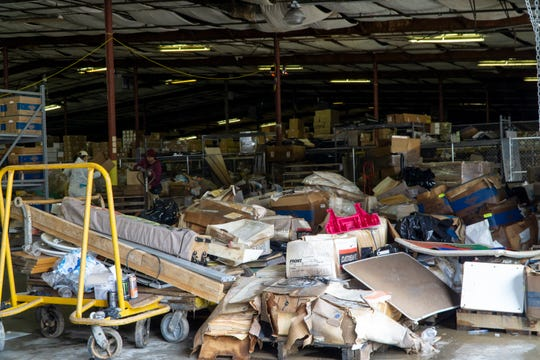 Flooded records at a Knoxville warehouse are shown following record-setting rainfall in the area. Water levels reached all but the top shelves of documents.