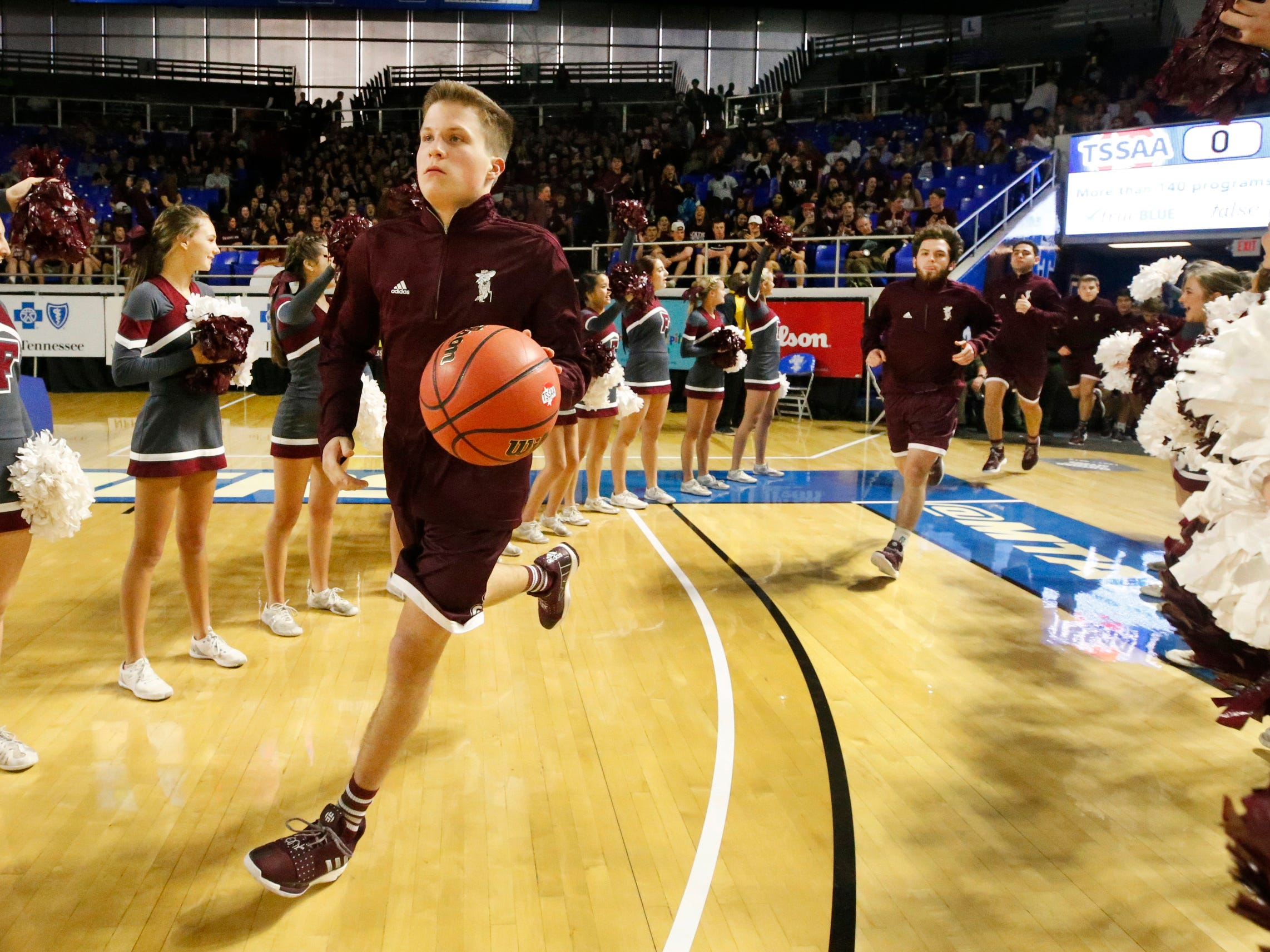 Franklin's Finlay Long (15) leads his team onto the court to warm-up before the quarterfinal round of the TSSAA Class AAA Boys State Tournament against Bearden, on Wednesday, March 13, 2019, at Murphy Center in Murfreesboro, Tenn.