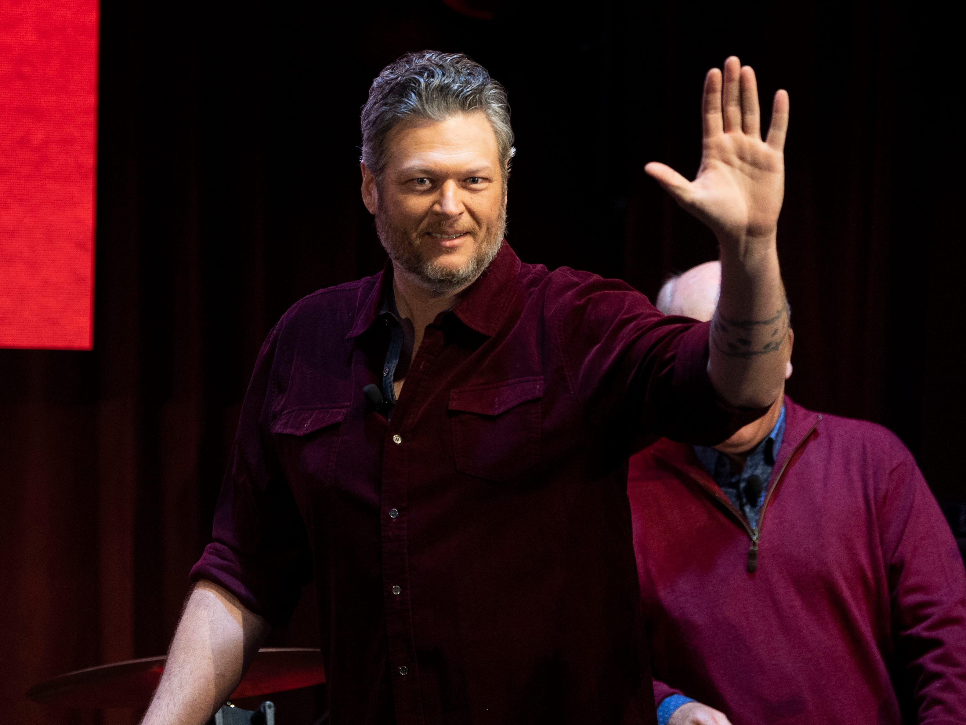 Blake Shelton waves to the small crowd gathered for a news conference for the grand opening Ole Red Gatlinburg on Wednesday, March 13, 2019.