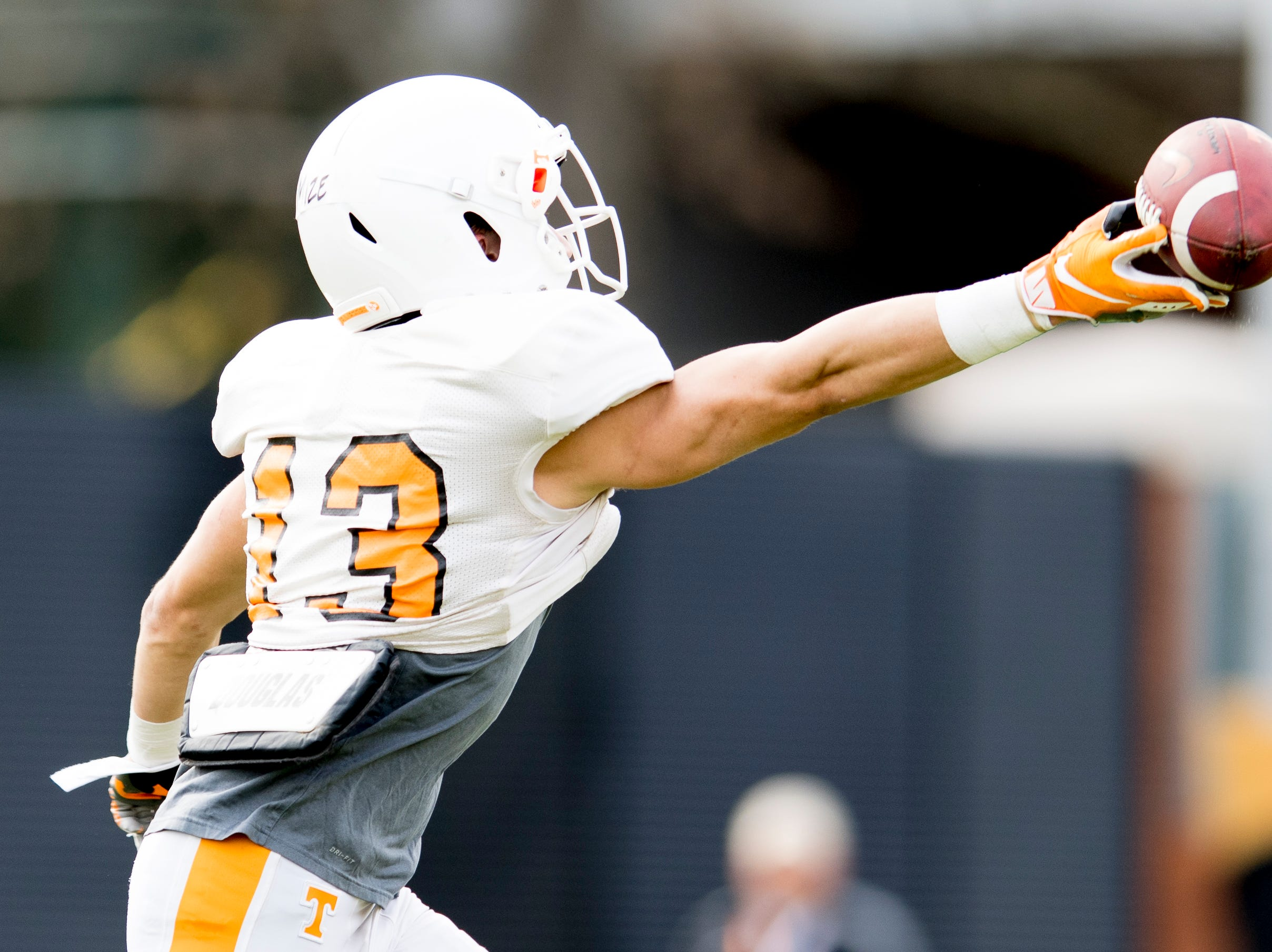Tennessee wide receiver Richard Mize Jr. (13) misses a pass during Tennessee spring football practice at  Haslam Field in Knoxville, Tennessee on Wednesday, March 13, 2019.