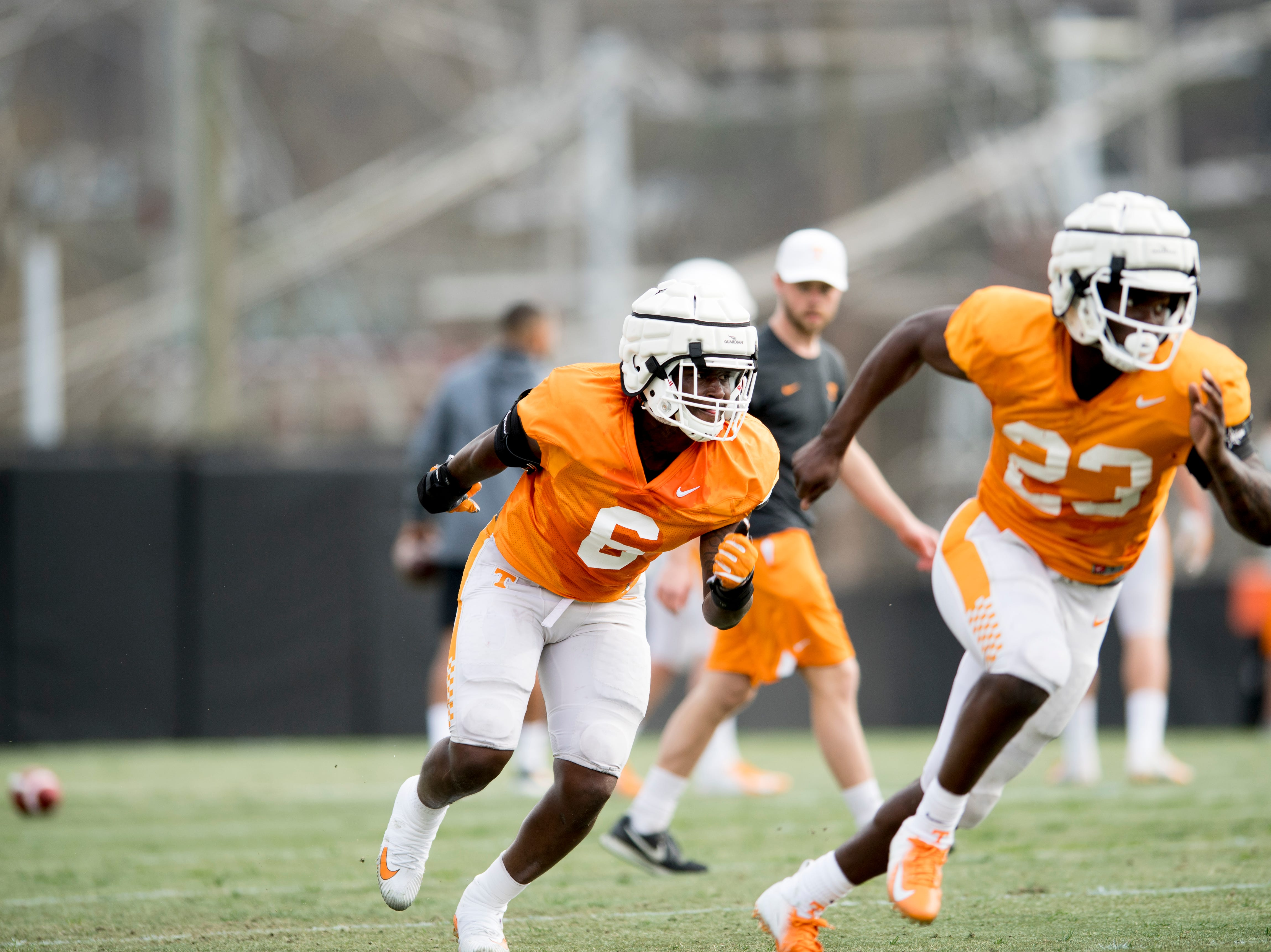 Tennessee linebackers JJ Peterson (6) and Will Ignot (23) run down the field during a drill during Tennessee spring football practice at  Haslam Field in Knoxville, Tennessee on Wednesday, March 13, 2019.
