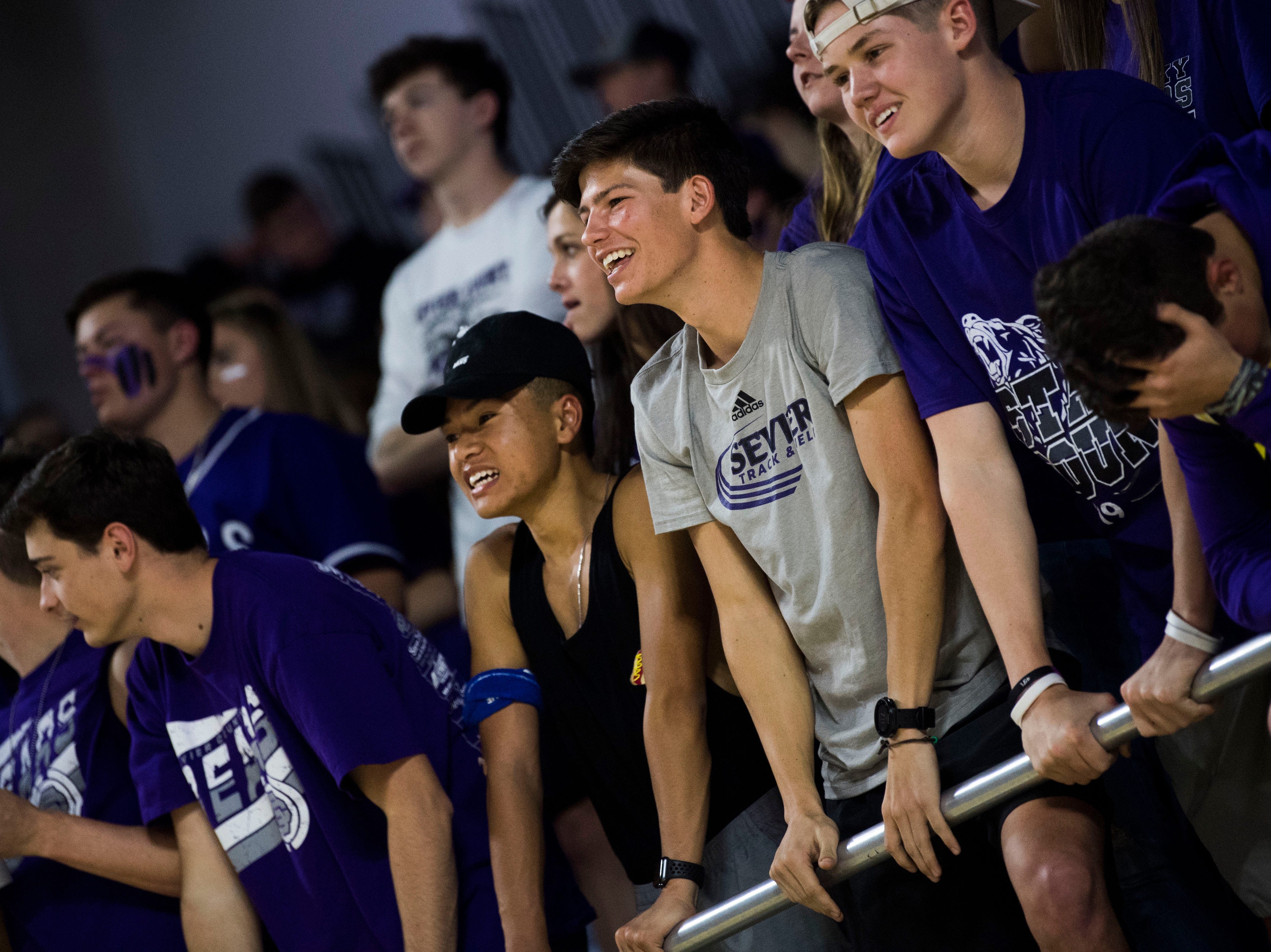 Sevier County fans cheer during a TSSAA AAA state quarterfinal game between Sevier County and Whitehaven at the Murphy Center in Murfreesboro, Wednesday, March 13, 2019.