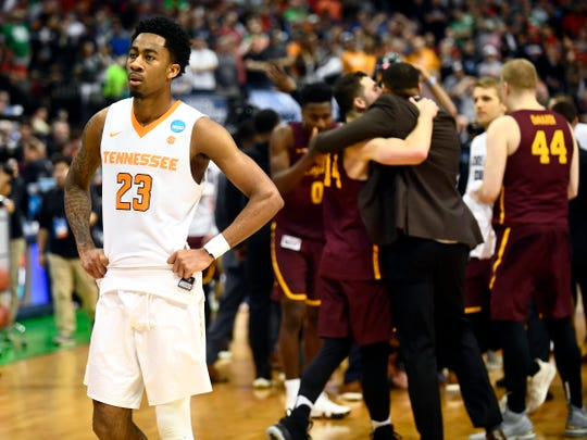 Tennessee guard Jordan Bowden (23) reacts as Loyola-Chicago players celebrate their 63-62 win March 17, 2018, in the NCAA Tournament second-round game at American Airlines Center in Dallas.