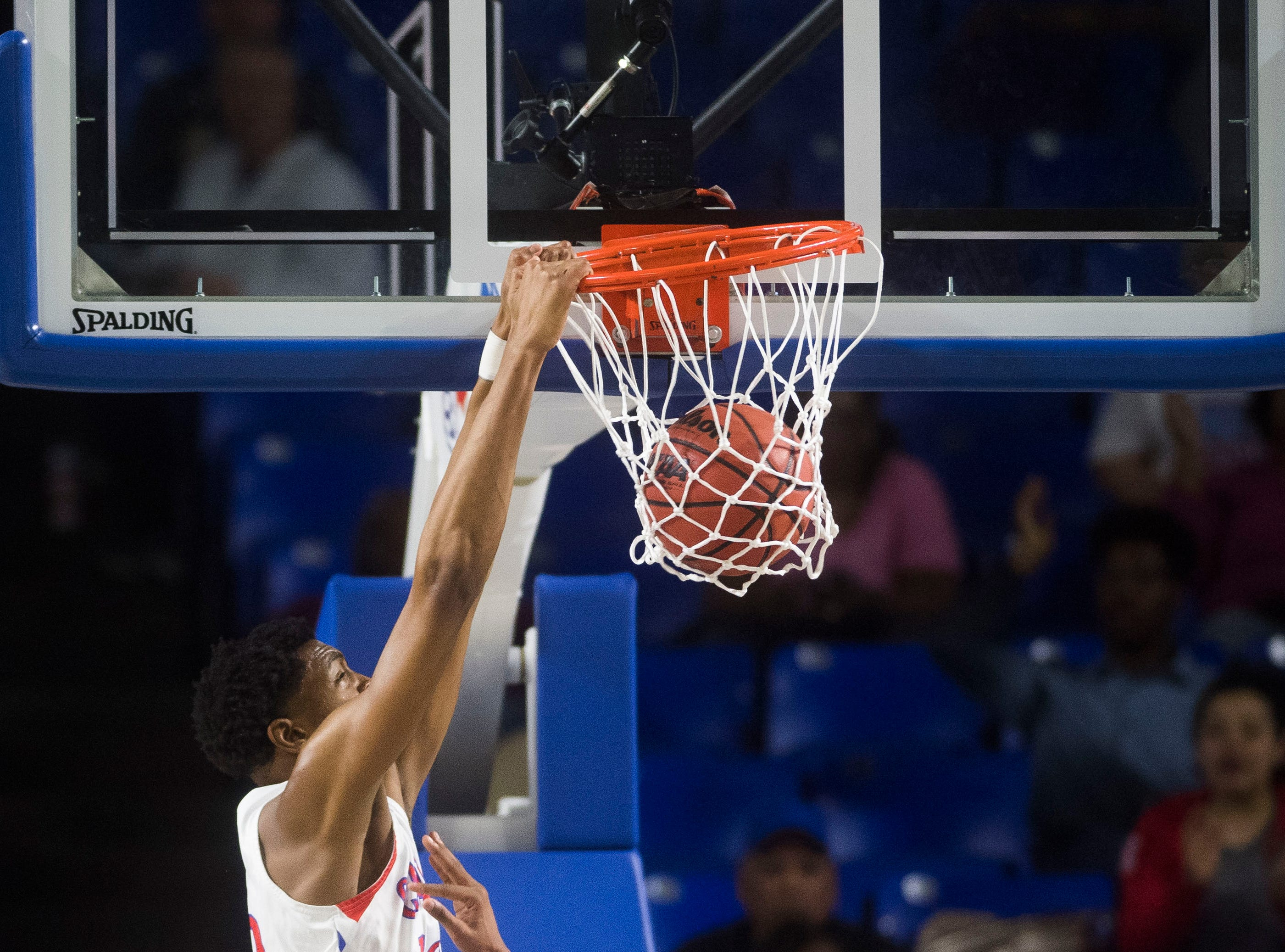 Wooddale's Chandler Lawson (13) dunks the ball during a TSSAA AA state quarterfinal game between Austin-East and Wooddale at the Murphy Center in Murfreesboro, Wednesday, March 13, 2019.
