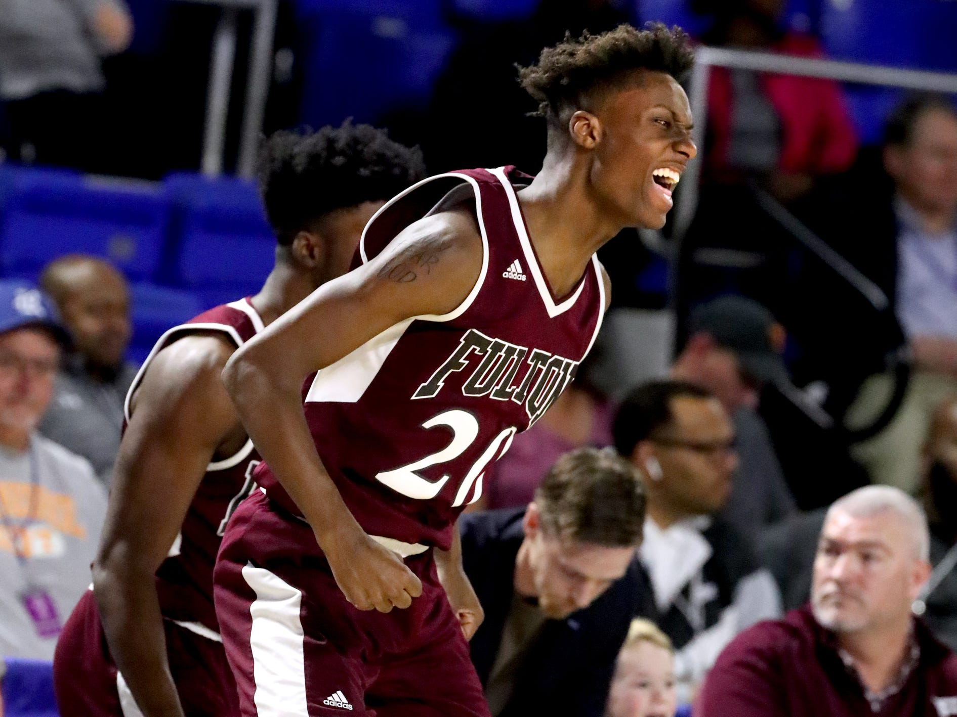 Fulton's Domenic Holland (20) celebrates being ahead of Mitchell during a time-out during overtime in the quarterfinal round of the TSSAA Class AA Boys State Tournament, on Wednesday, March 13, 2019, at Murphy Center in Murfreesboro, Tenn.