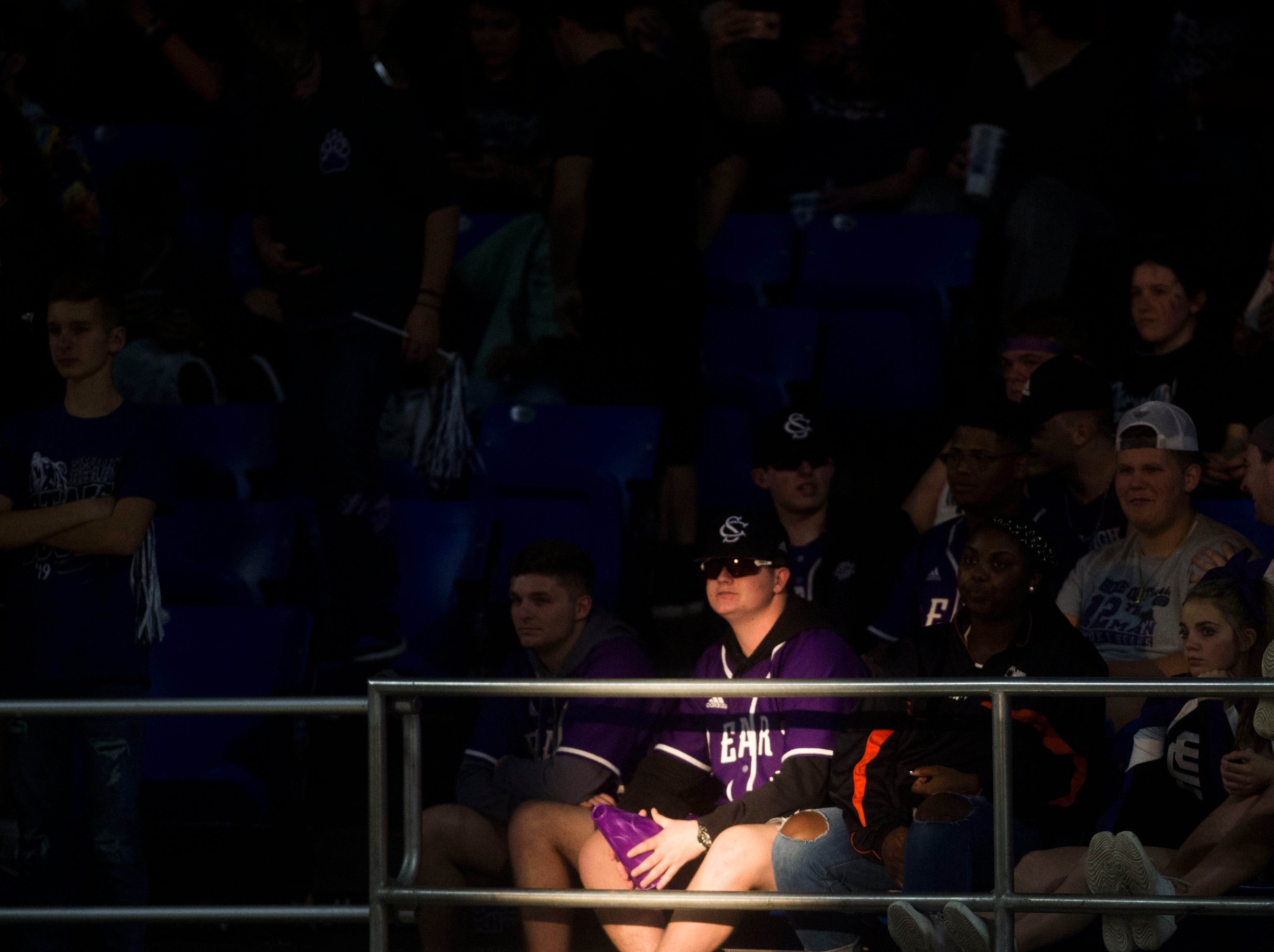 A Sevier County fan is hit my sunlight during a TSSAA AAA state quarterfinal game between Sevier County and Whitehaven at the Murphy Center in Murfreesboro, Wednesday, March 13, 2019.