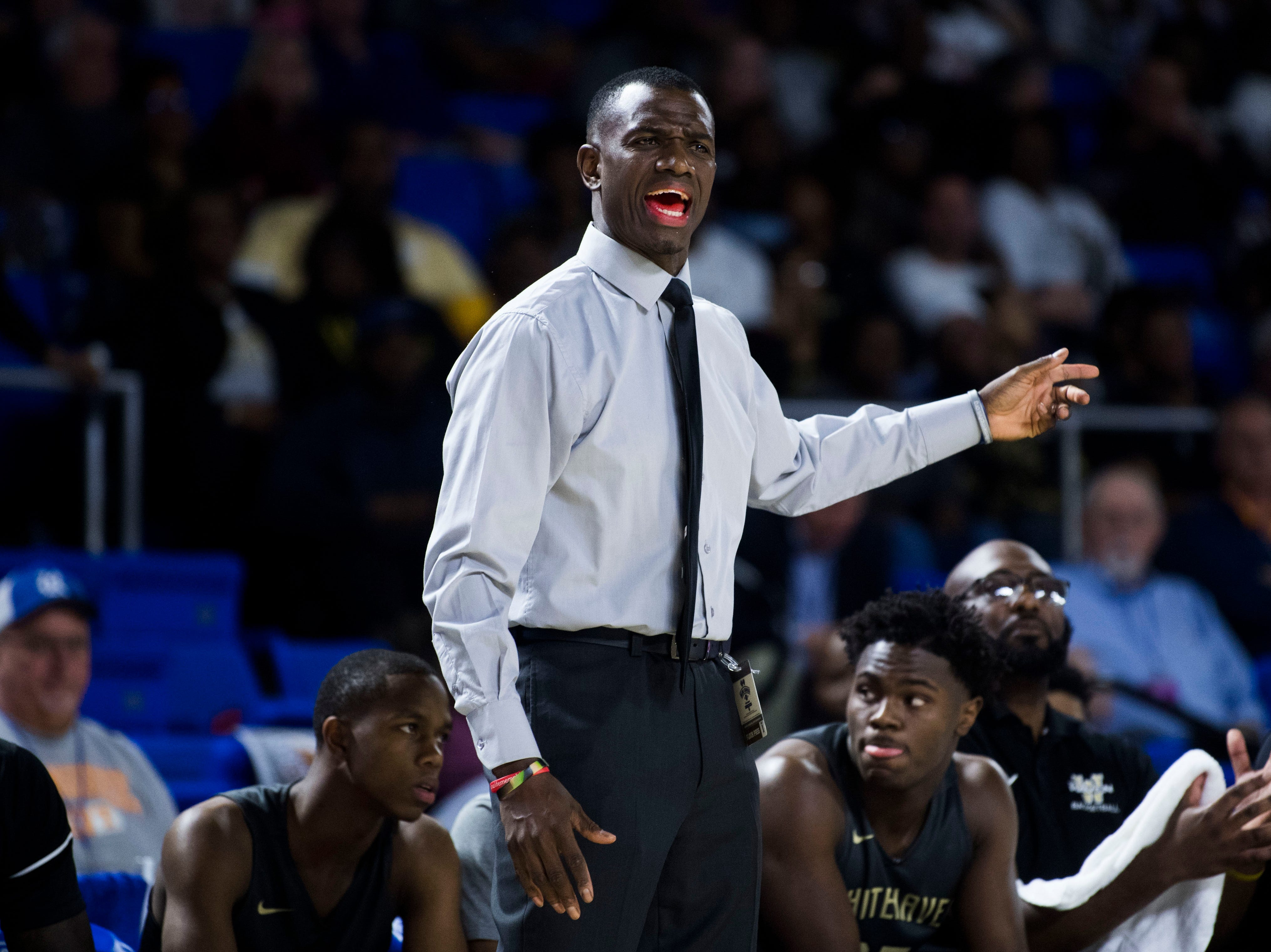 Whitehaven's head coach Faragi Phillips yells to the court during a TSSAA AAA state quarterfinal game between Sevier County and Whitehaven at the Murphy Center in Murfreesboro, Wednesday, March 13, 2019.