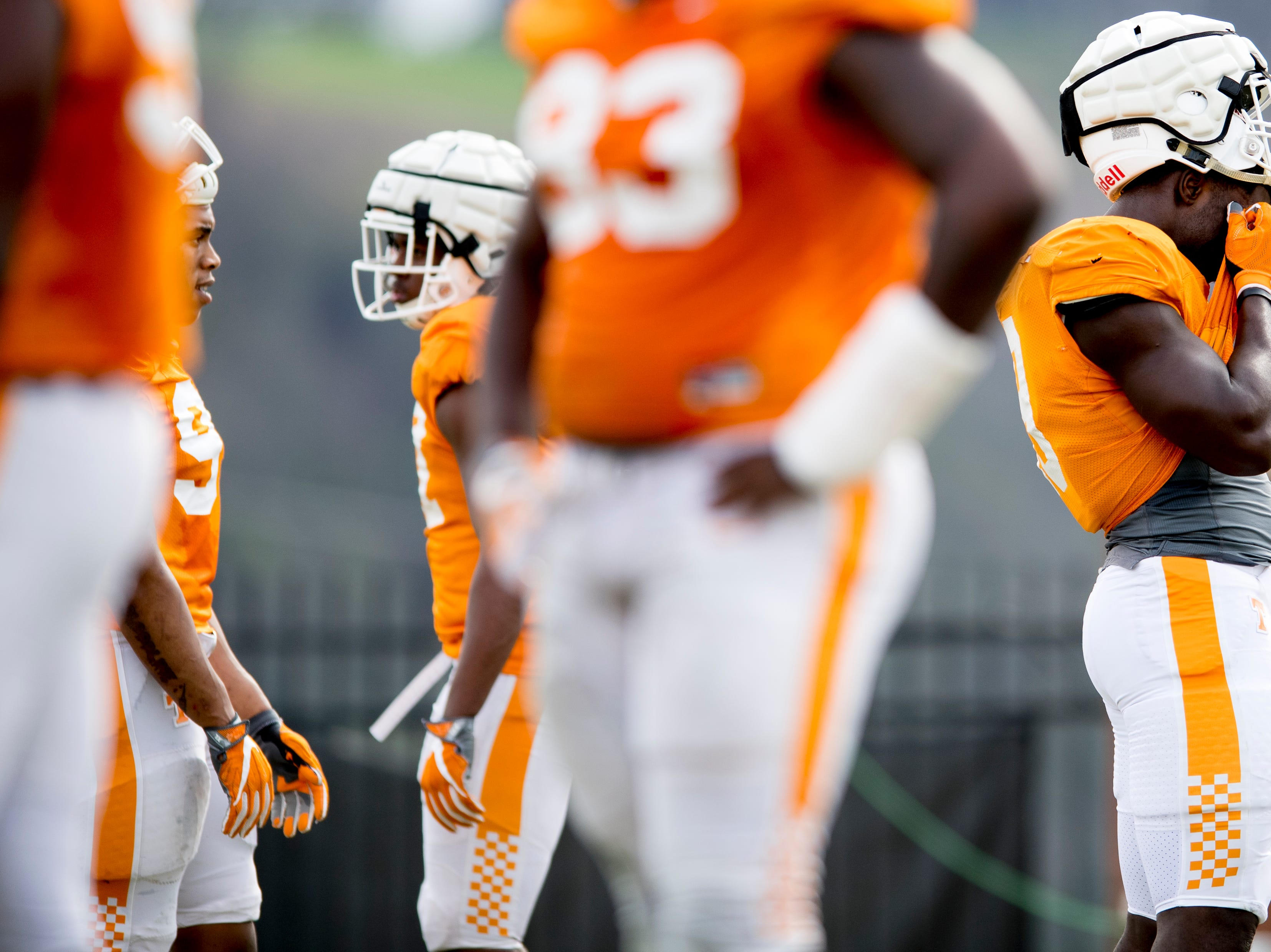 A player wipes their face during Tennessee spring football practice at  Haslam Field in Knoxville, Tennessee on Wednesday, March 13, 2019.