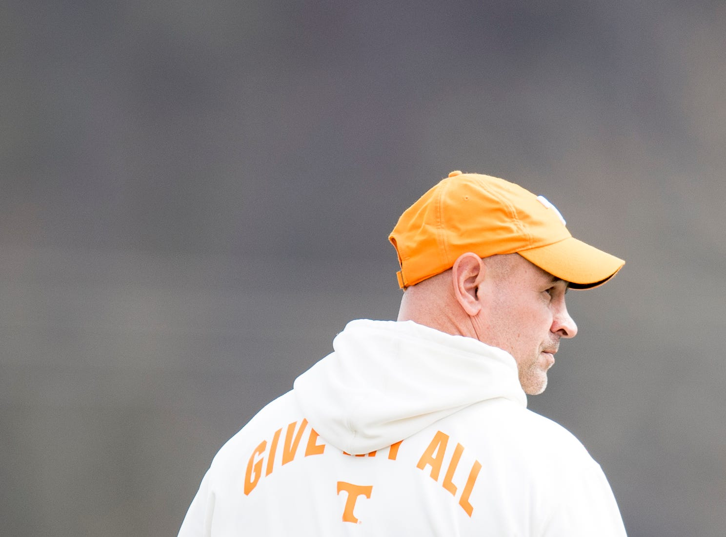 Tennessee Head Coach Jeremy Pruitt walks on the field during Tennessee springJfootball practice at  Haslam Field in Knoxville, Tennessee on Wednesday, March 13, 2019.
