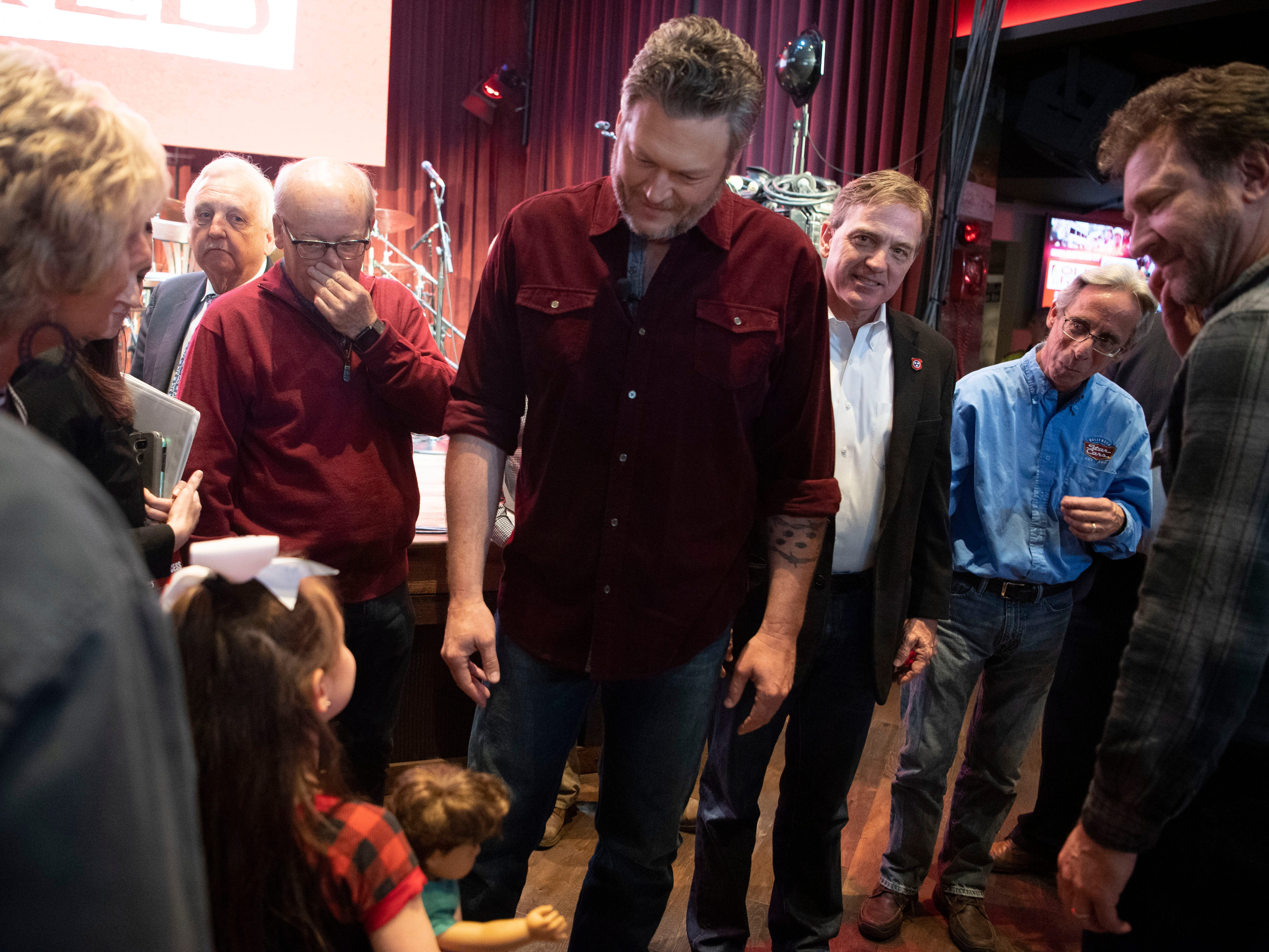 Blake Shelton meets a young fan during the grand opening news conference for Ole Red Gatlinburg on Wednesday, March 13, 2019.