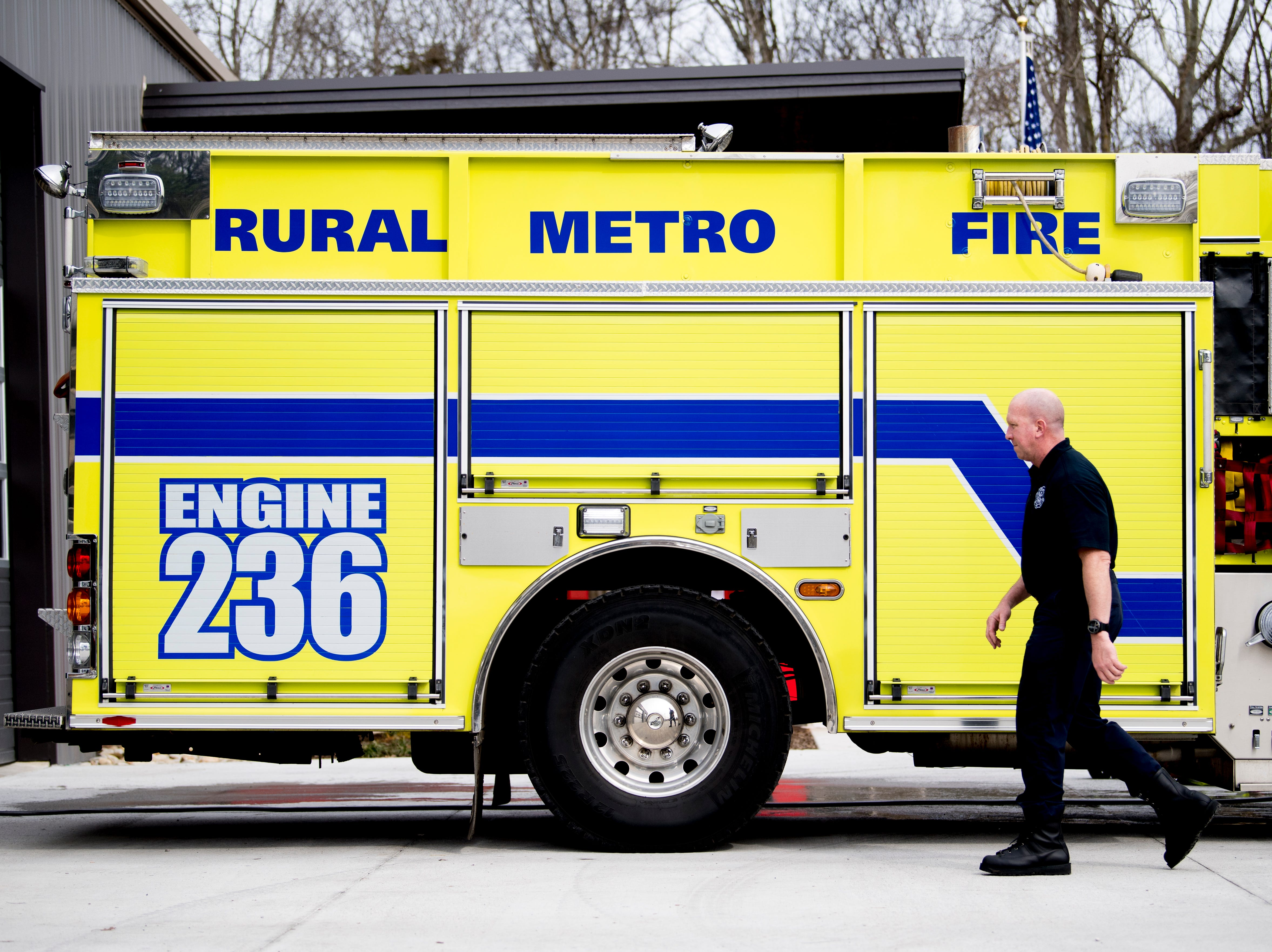 Captain Chuck McNeil walks past Engine 236 at the new Rural Metro Fire Station 36, 7615 Norman Jack Lane, in Powell, Tennessee on Wednesday, March 13, 2019. The station has been operational since early February and is hosting an open house and grand opening March 14 from 10am-7pm.