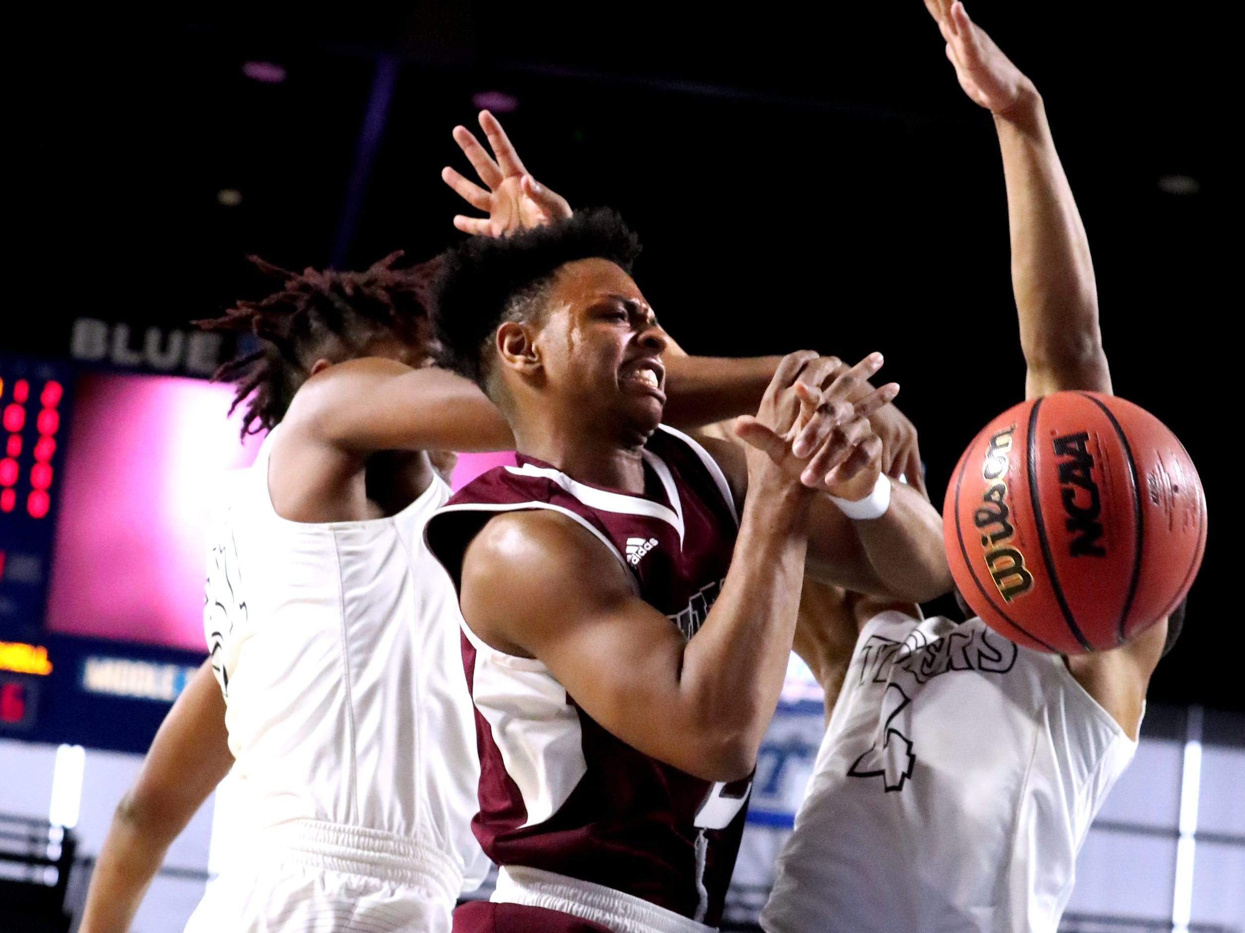 Fulton's Tommy Sweat (22) and Mitchell's Mikell Rice (1) both fight for position during the quarterfinal round of the TSSAA Class AA Boys State Tournament, on Wednesday, March 13, 2019, at Murphy Center in Murfreesboro, Tenn.